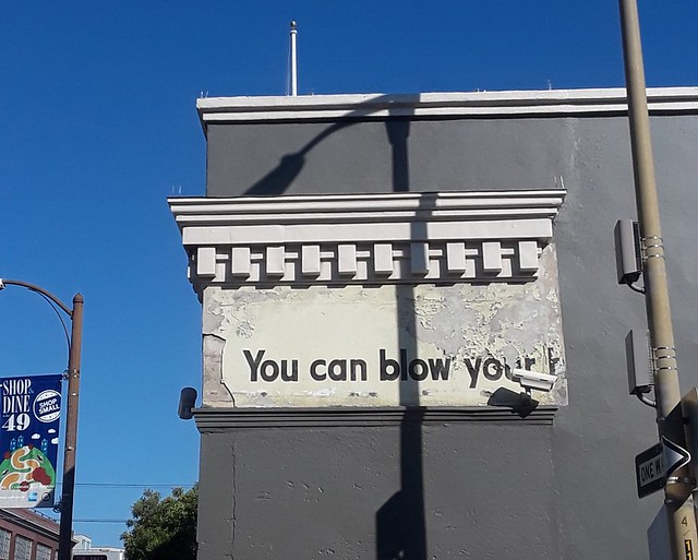 """""""You can blow your h..."""" Partial ad on 430 3rd, as seen from Stillman Street. My guess is that it's from this  Kleenex ad,  circa late 40's/early 50's."""