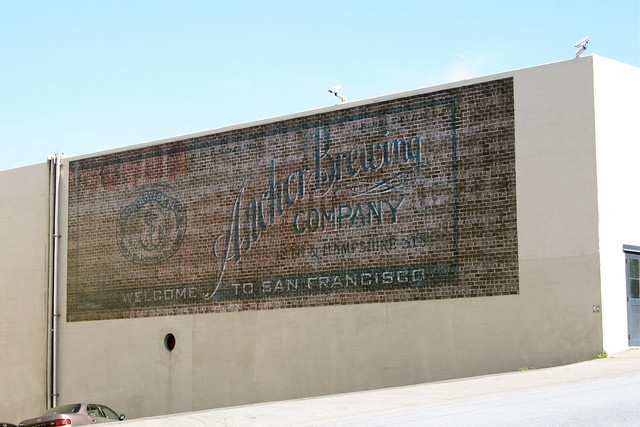 1705 Mariposa. Old sign on the side of the Anchor Steam Brewery. Anchor Steam was founded in 1871 by Gottlieb Brekle. Originally a saloon/Brewery on Russian Hill, it was renamed Anchor around 1876. After several locations/owners it moved to Potrero Hill in the 1930's.  The current building was built in 1937 for a local food company and was bought by Anchor Steam in the 1970's.