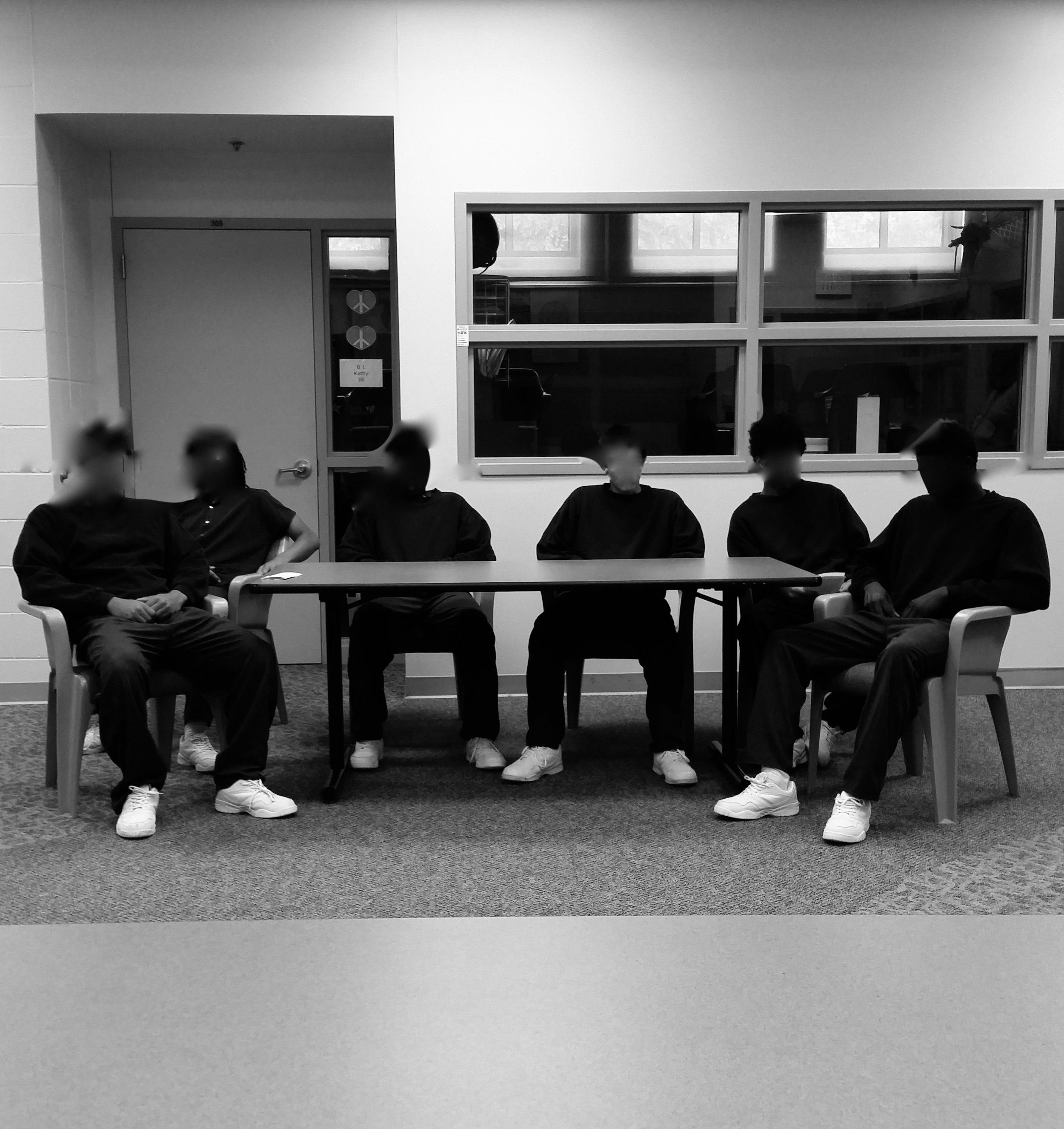 Youth workshop in Des Moines, IA Detention Center. (Faces blurred for anonymity.)