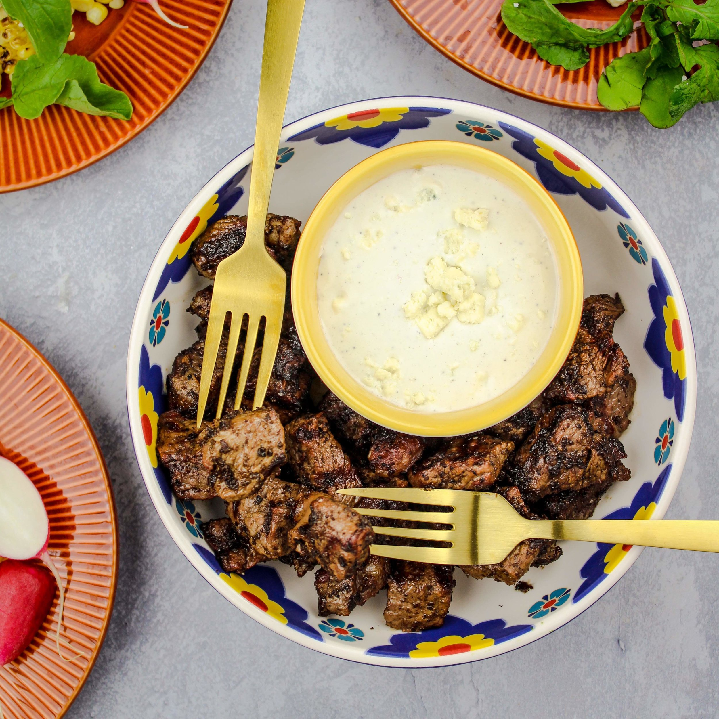 Grilled Ribeye Steak Bites with butter and gorgonzola