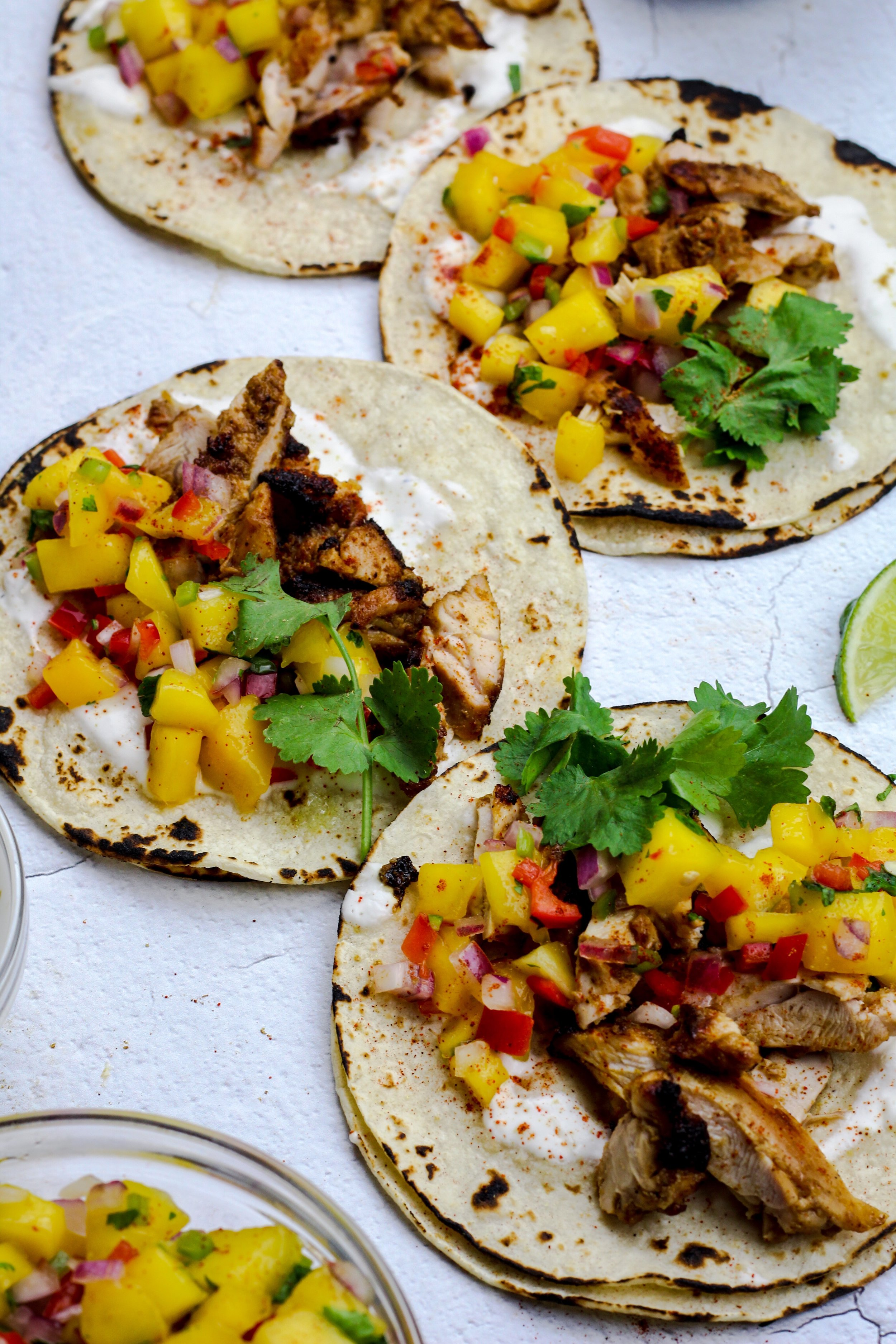 Chicken Tacos with Mango Salsa and Lime Crema