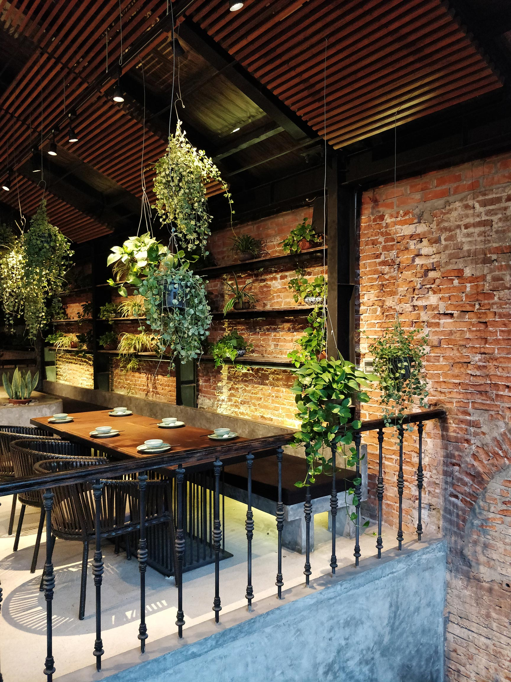 Industrial interior softened with plants