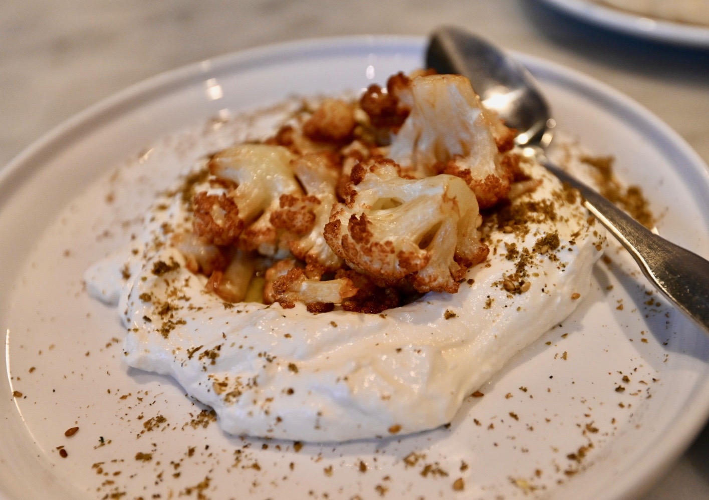 Roasted cauliflower,  labneh , dusted with  za'atar.