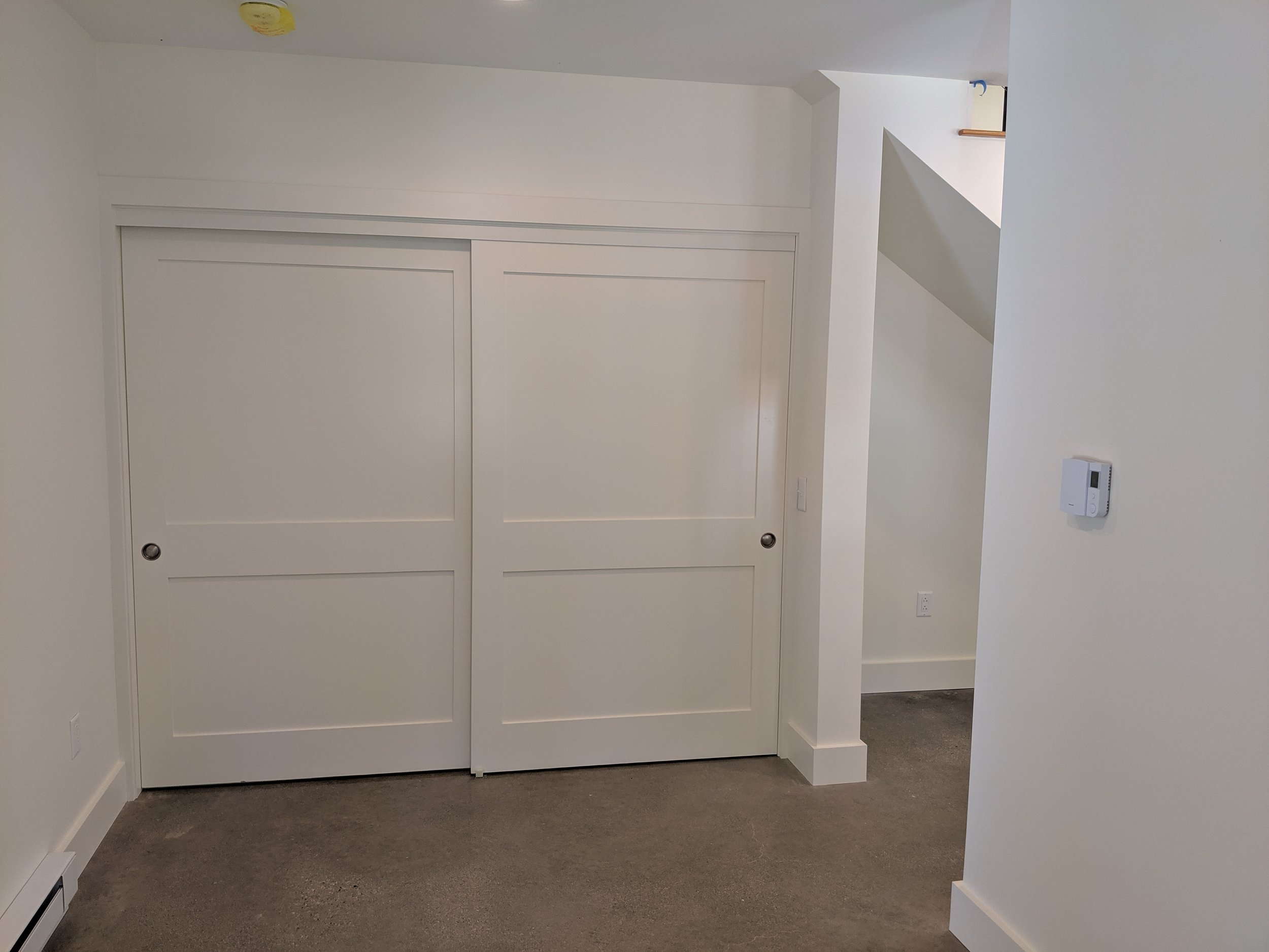 8' Bypass Solid core Doors with Poplar Trim, Polished Concrete Floors