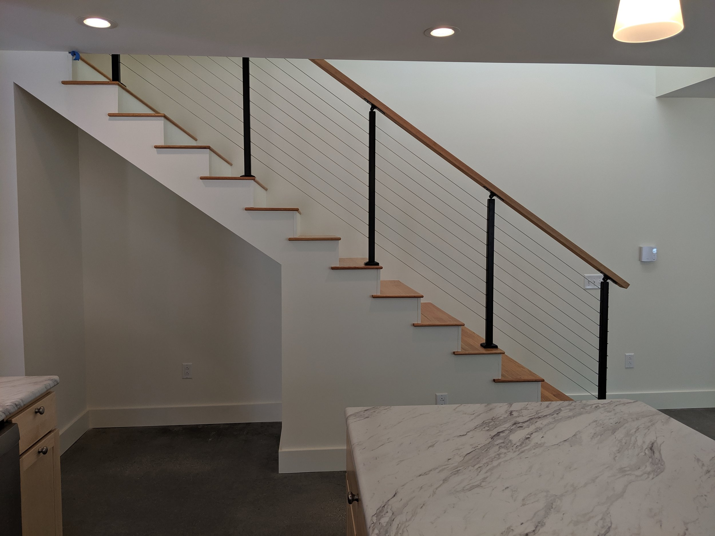 Staircase with Custom Cable Rails + Oak Treads