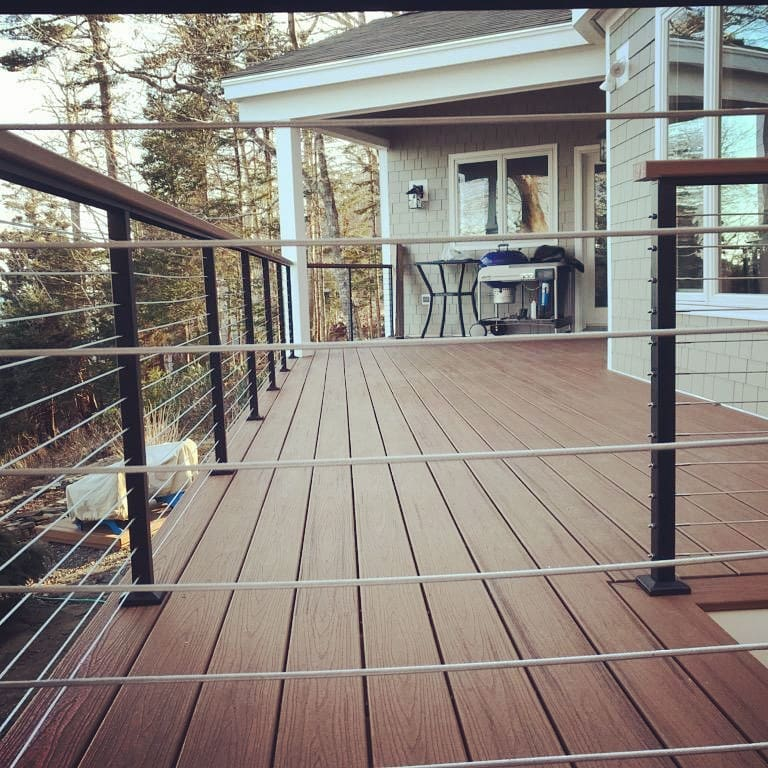 Decks + Screen Porches - Decks and screened porches are the outside living element to every home. Whether it's replacing decking and railings on your existing structure or building a new deck or screened porch. Medomak Construction knows decks and screen porches. There are many decking and rail manufacturers, but they aren't all made equal. Leave it to us to determine what options you have to fit your budget and design vision. We are certified installers of Trex Decking + Rails, Timbertech Decking and Azek Decking + Railings. We also work frequently with companies like Atlantis Rail (shown in photo) and Wild Hog Railing. Whether you're looking for a simple Pressure Treated deck or are looking to build a large outdoor entertaining space, we want to hear from you!