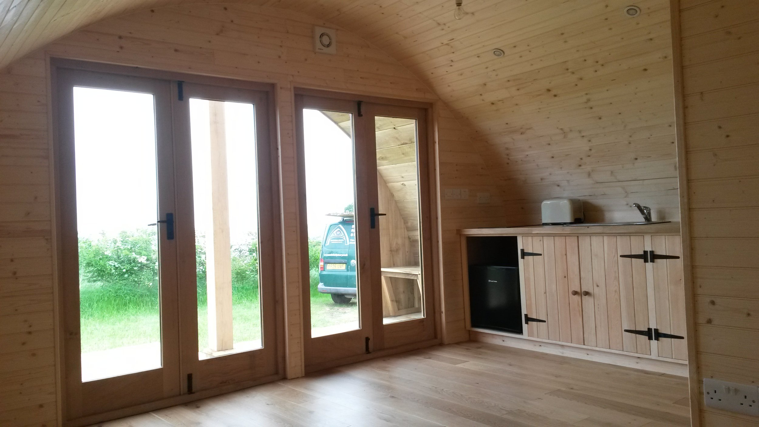 glamping pod with kitchen and shower