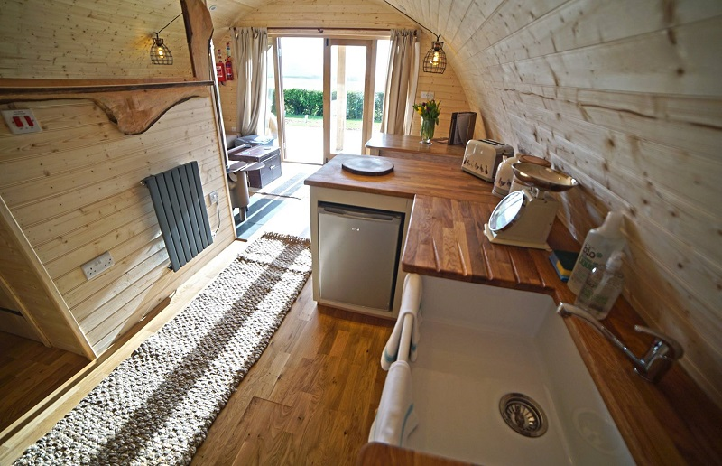 custom made kitchen in glamping  log cabin