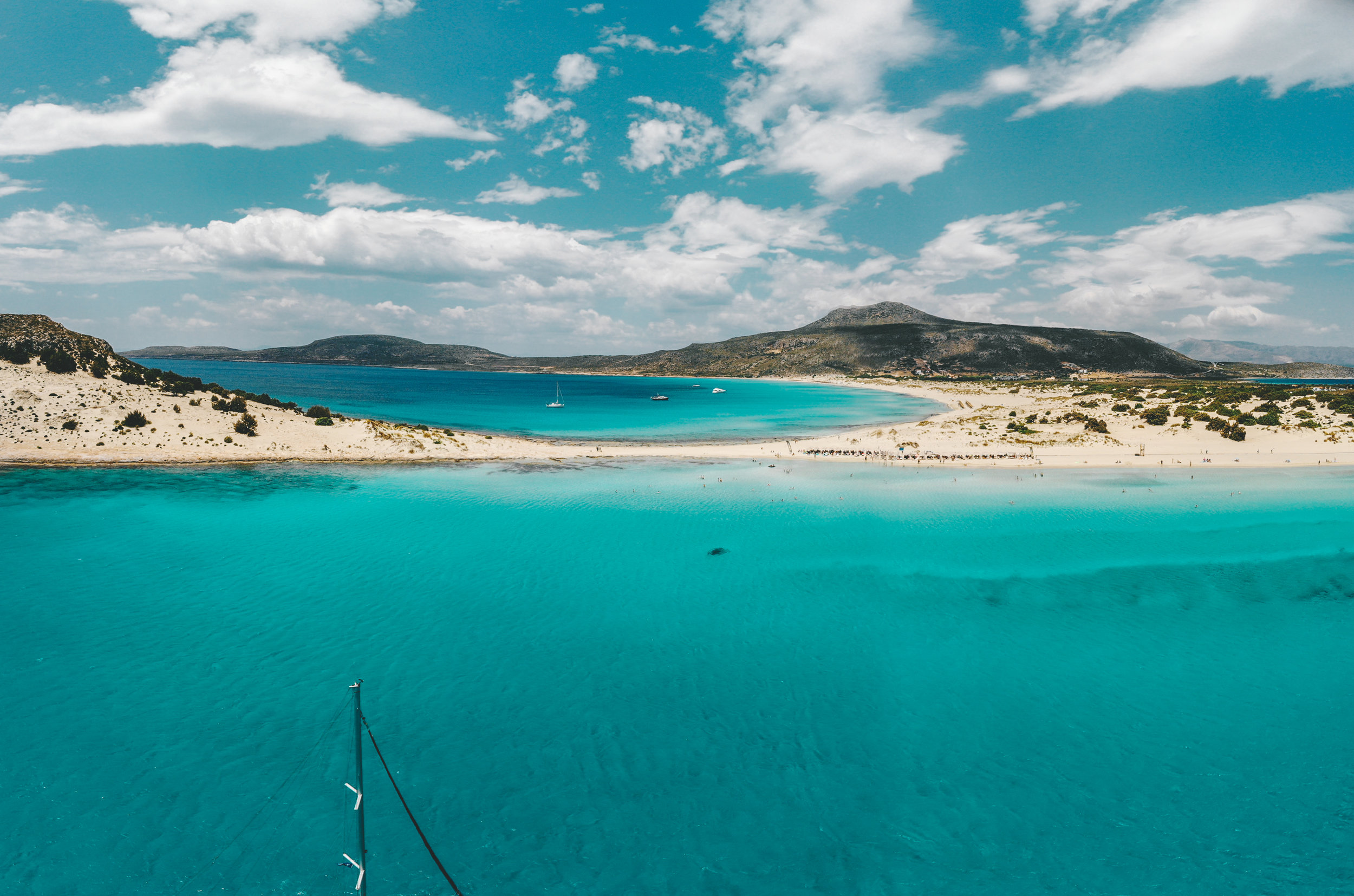 Beach in Lakonia, Peloponnese. Photo by  Alex Antoniadis  via Unsplash.