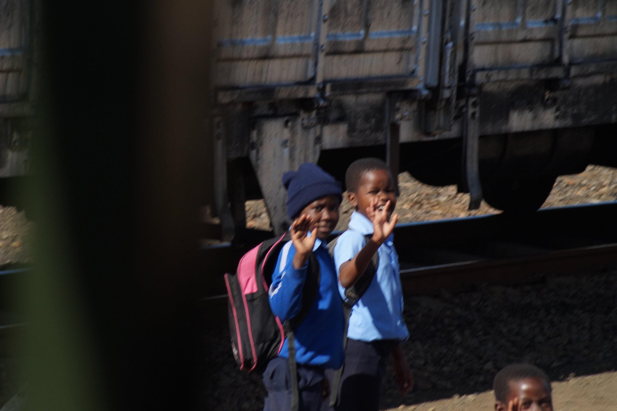 School children enroute to school along the railway line.