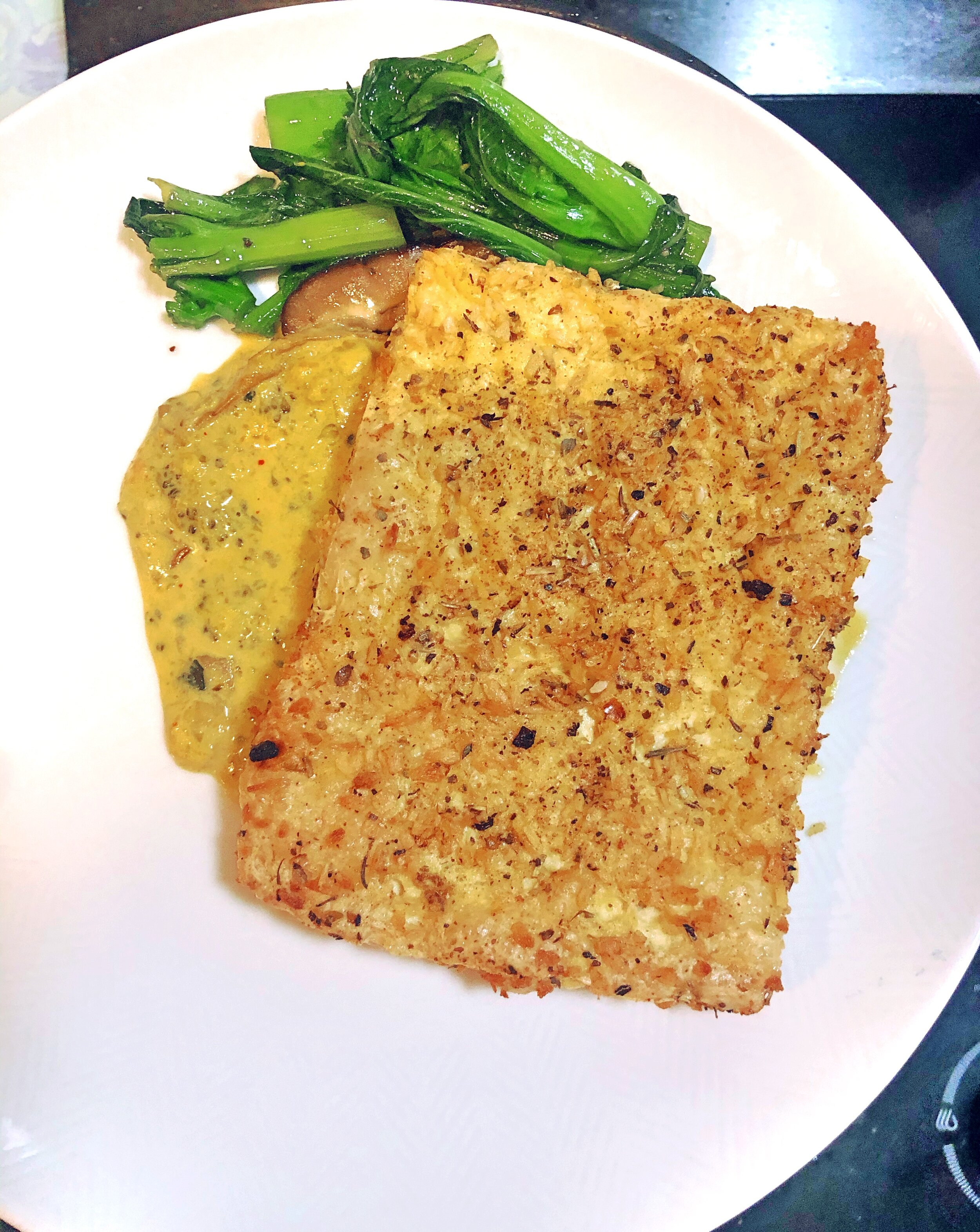"""One of my favourites here!  Ingredients: Organic Firm Tofu.  Coating:  Desiccated Coconut, Italian herbs, S+P, Olive oil,  Method: Pre-heat the oven to medium high, mix the coatings together and then slice the pressed tofu into 1"""" length slices, carefully coat in the mixture then place on to a lined baking tray and drizzle with oil. Bake for 15 minutes.  I served it along side some shiitake mushrooms and choi sum and homemade yellow curry sauce. Simply delicious !!"""