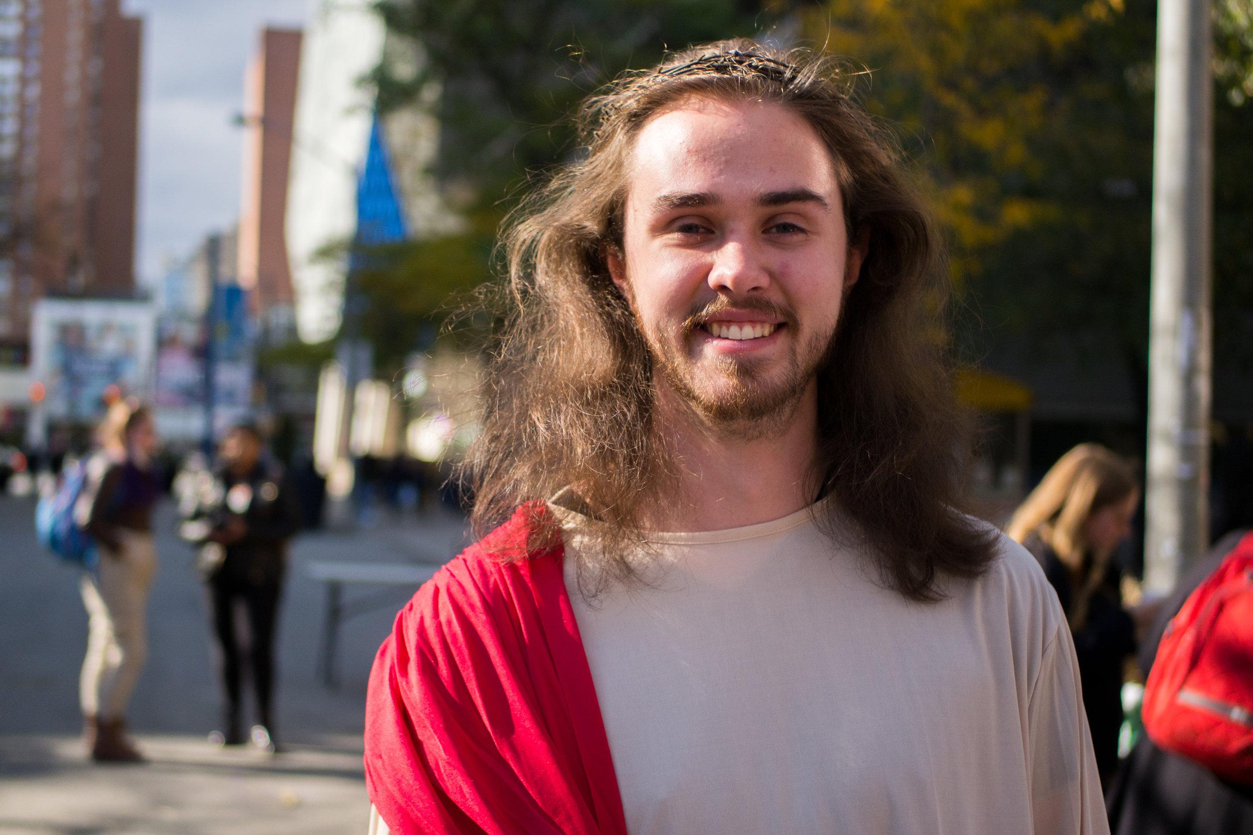 John Corkill, 20, walks around campus in his Jesus costume. (J. Cameron/CanCulture)