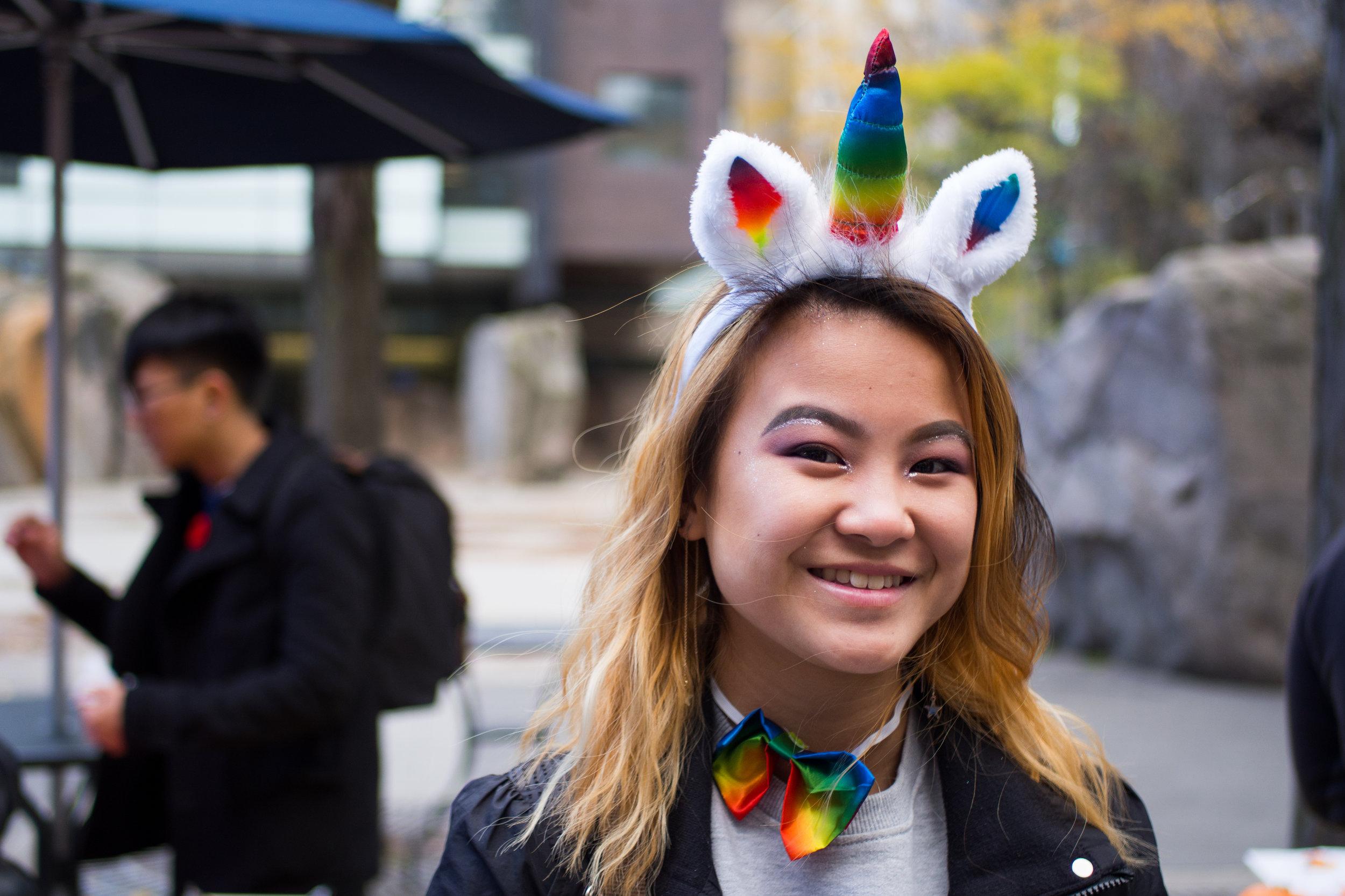 Karmen Man, 18, walks around the fall festival in her unicorn costume. (J. Cameron/CanCulture)