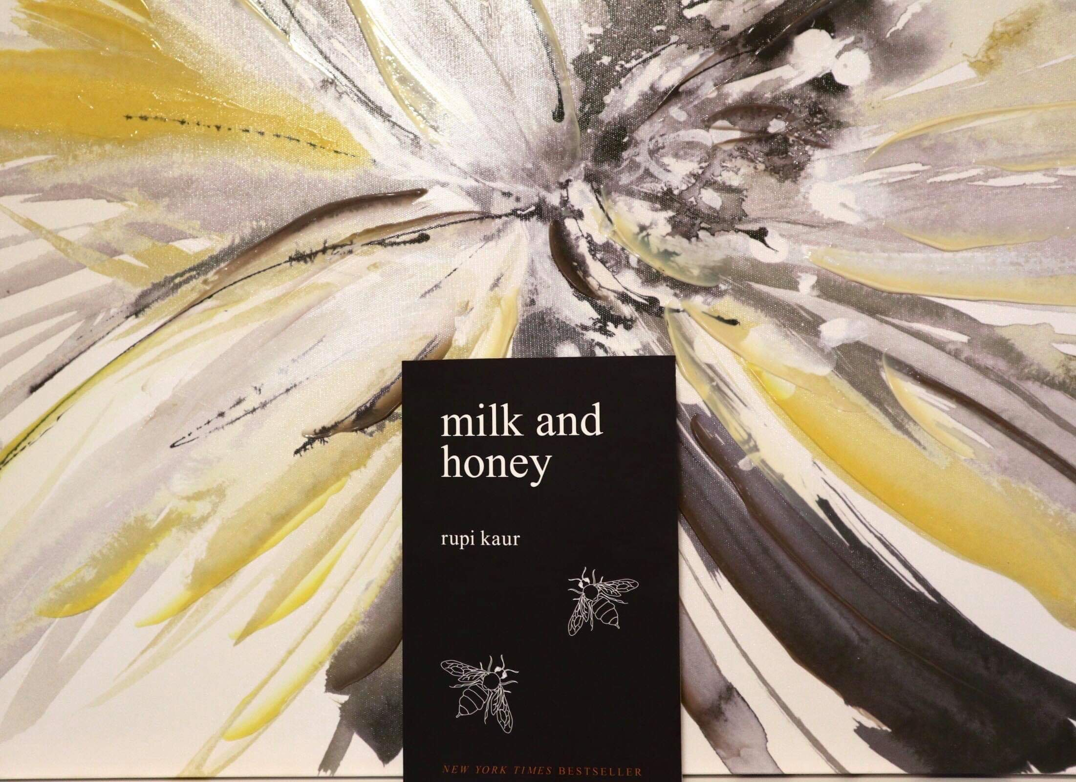 Two illustrated bees can be seen on the dark cover of  Milk and Honey.  (CanCulture/Mariah Siddiqui)