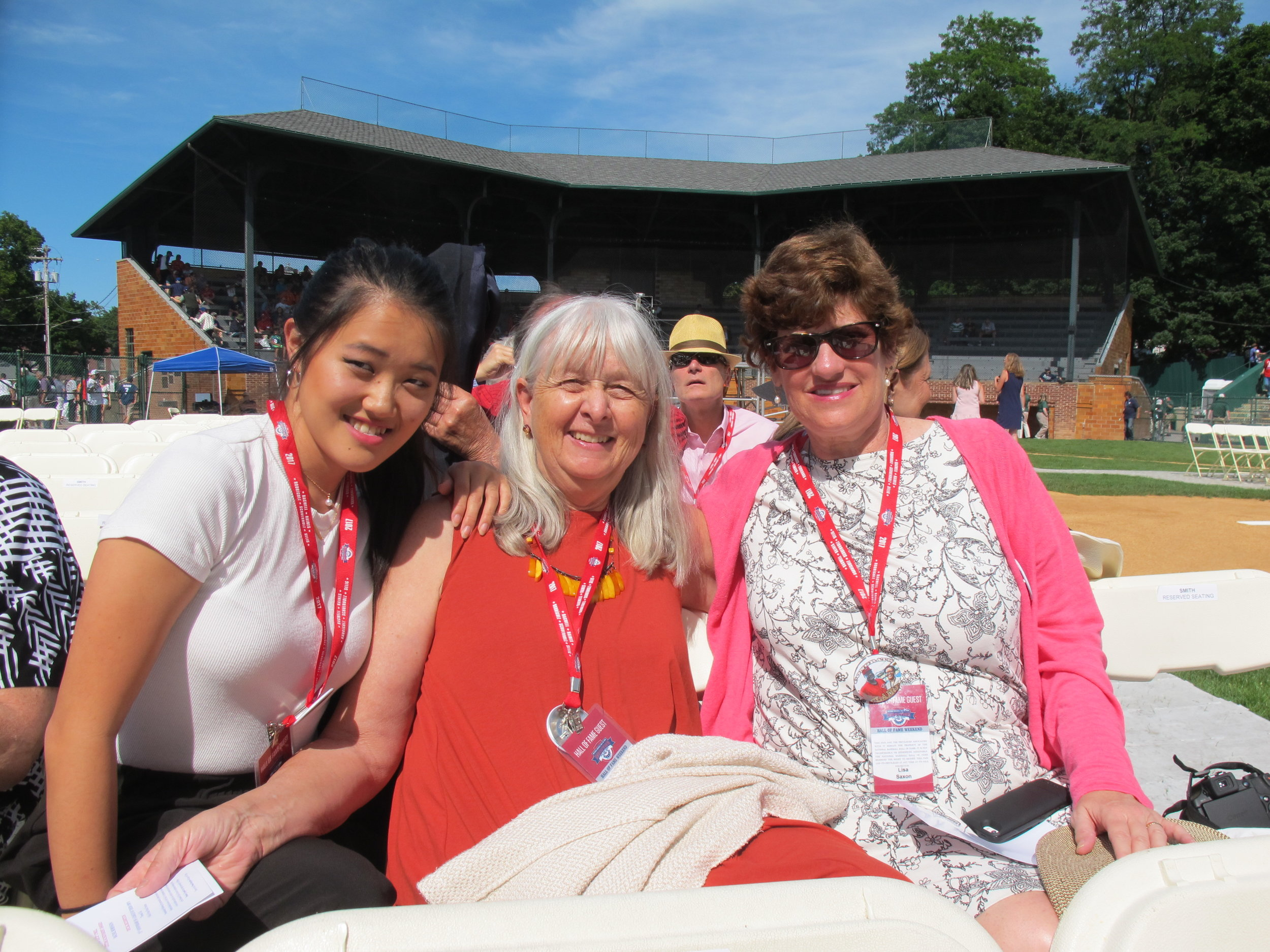 Lisa Nehus Saxon, right, Melissa Ludtke, center, Maya Ludtke (Melissa's daughter), left at the Baseball Hall of Fame's baseball diamond for the hall's induction of Claire Smith. July 2018