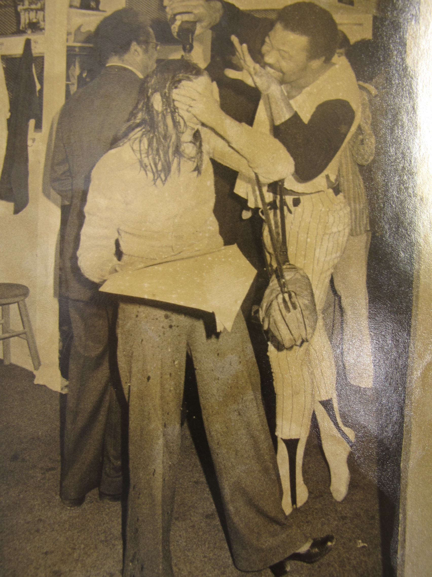 Cliff Johnson pours Champagne over Melissa Ludtke's head in the New York Yankees locker room, 1978