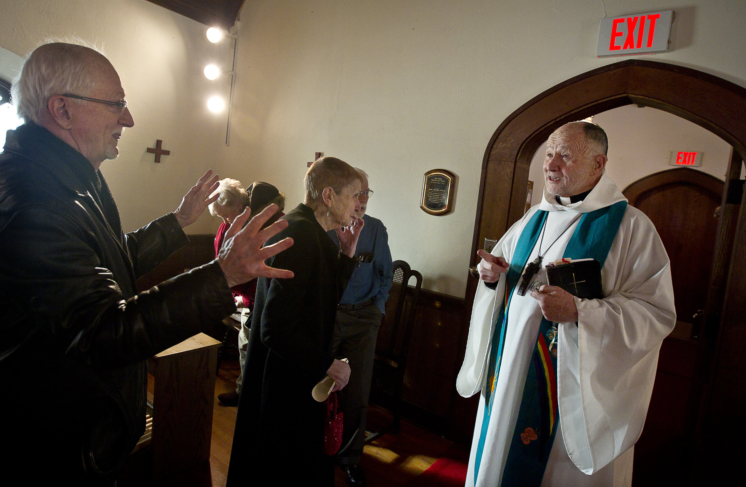 NORTH LAKE, WI — JANUARY 18, 2015: Reverend David Couper delivers the homily during during mass at St. Peter's Episcopal Church, Sunday, January 18, 2015.