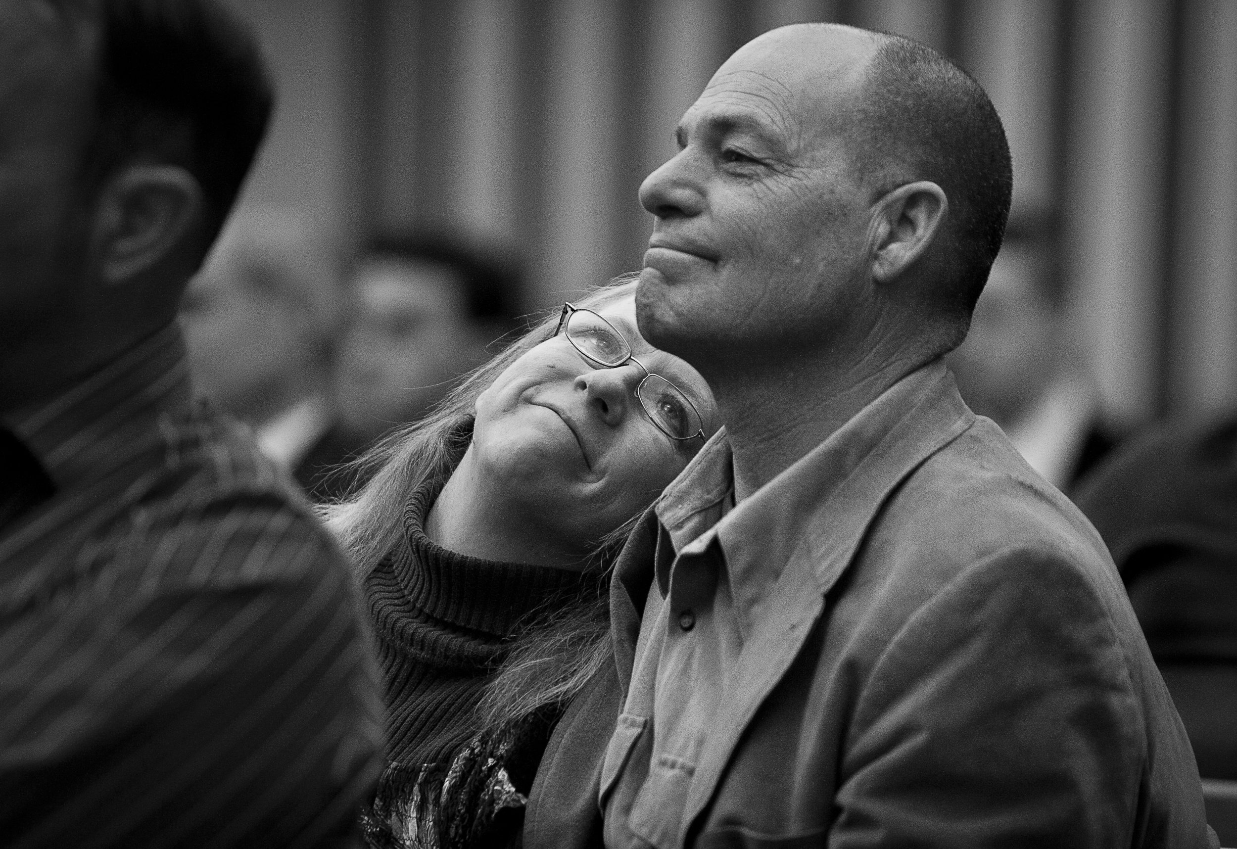 Terri Smith looks up at her husband Mike lovingly during the Fremont Branch testimony meeting, Sunday, Jan. 6, 2013.