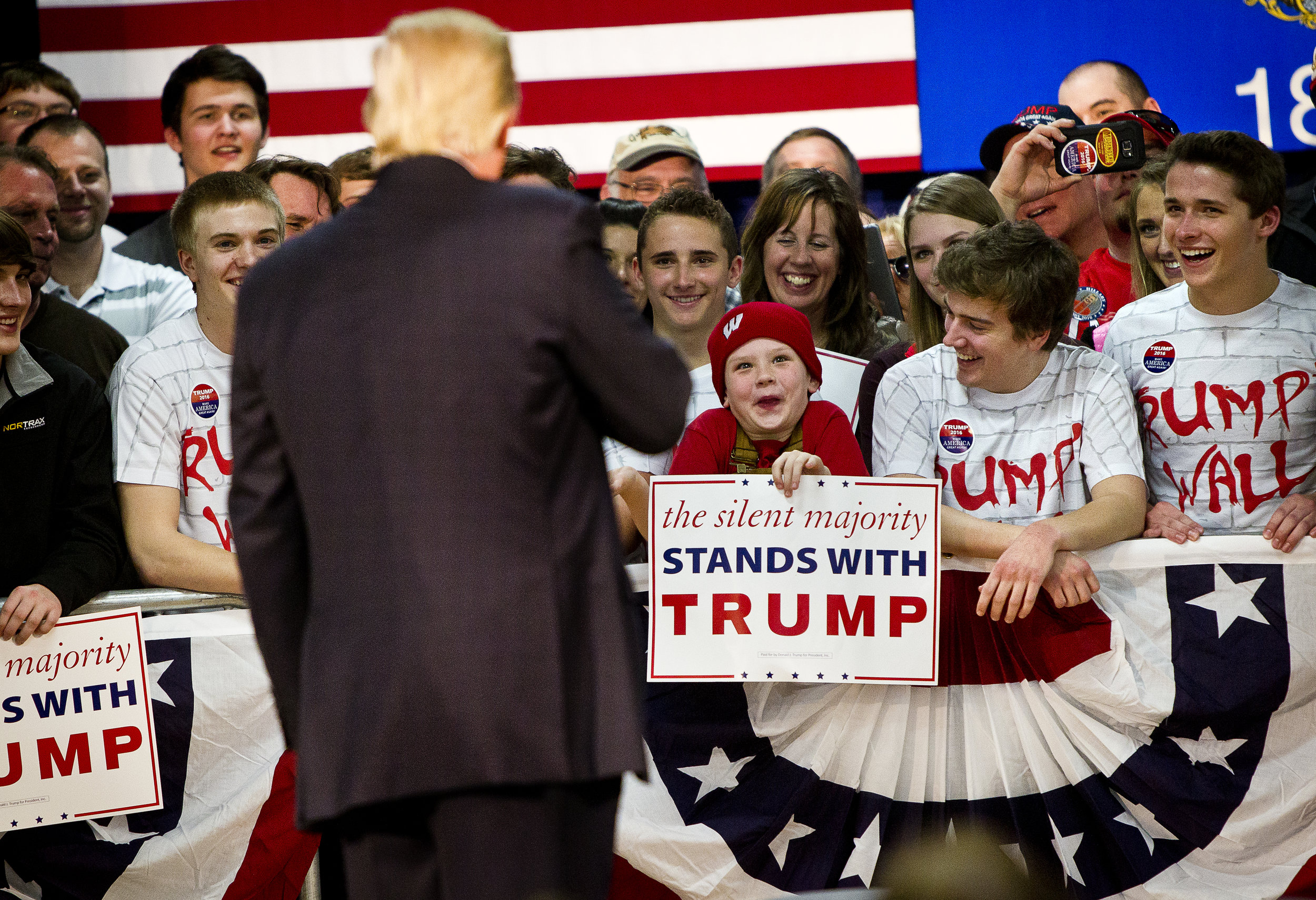 young Donald Trump supporter reacts to being talked about by the Republican U.S. presidential candidate at a campaign town hall event in Wausau, Wisconsin April 2, 2016.   REUTERS/Ben Brewer