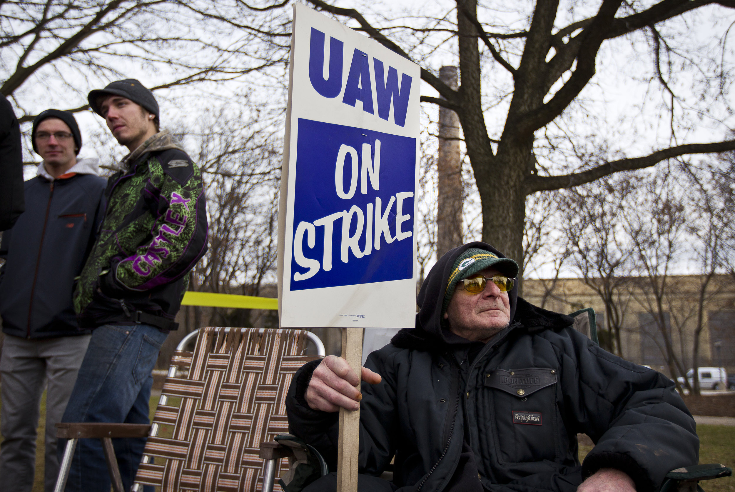 KOHLER, WI — DECEMBER 9, 2015: Dale Mand, a Kohler employee of 43 years in the Engine plant, looks on at other Local UAW 833 strikers outside the Kohler facility, Tuesday, December 8, 2015. Around 2,100 Kohler employees and union members are currently maintaining a 24/7 picket line outside the plant.