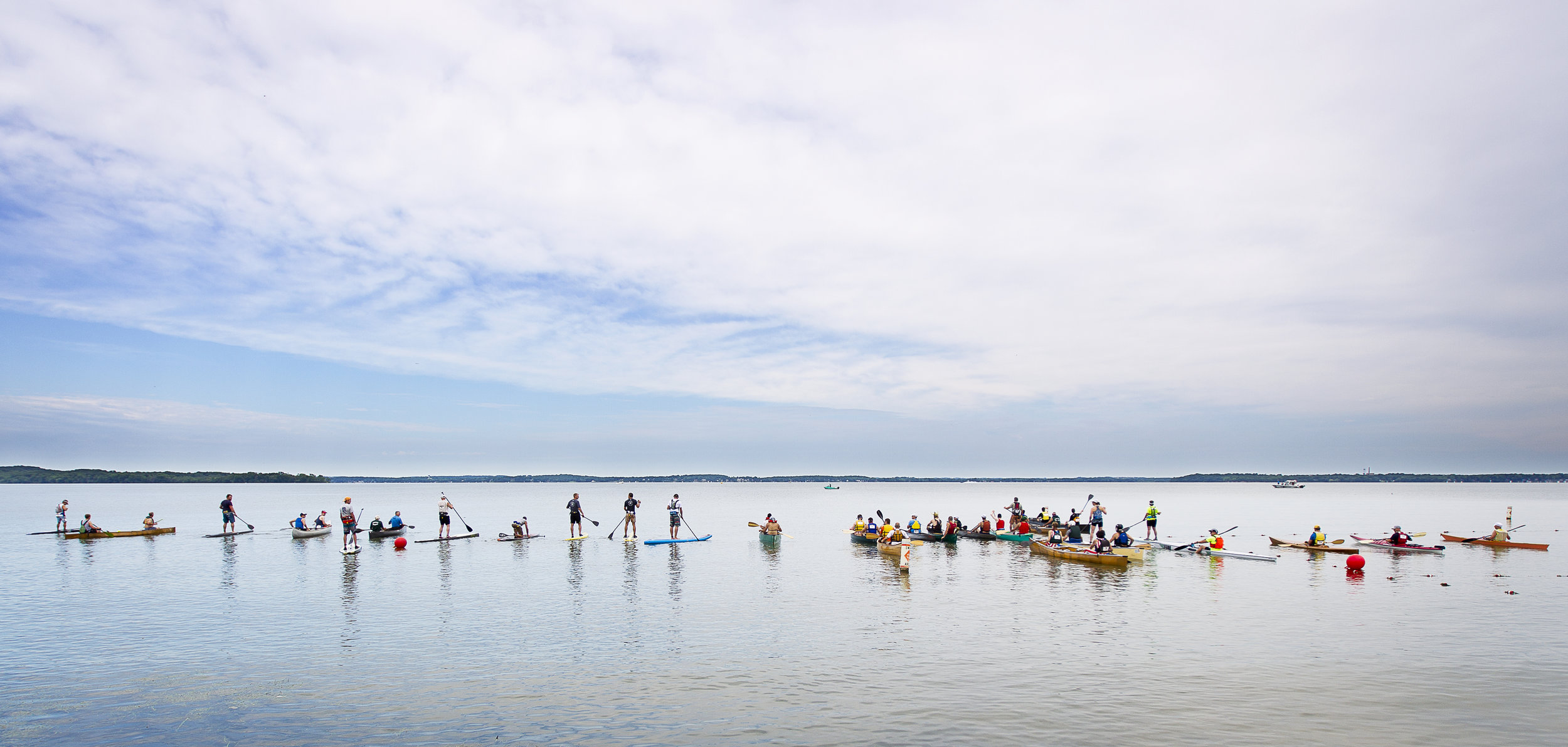 Kayaks and canoes line up before the Paddle and Portage event, Saturday, July 18, 2015.