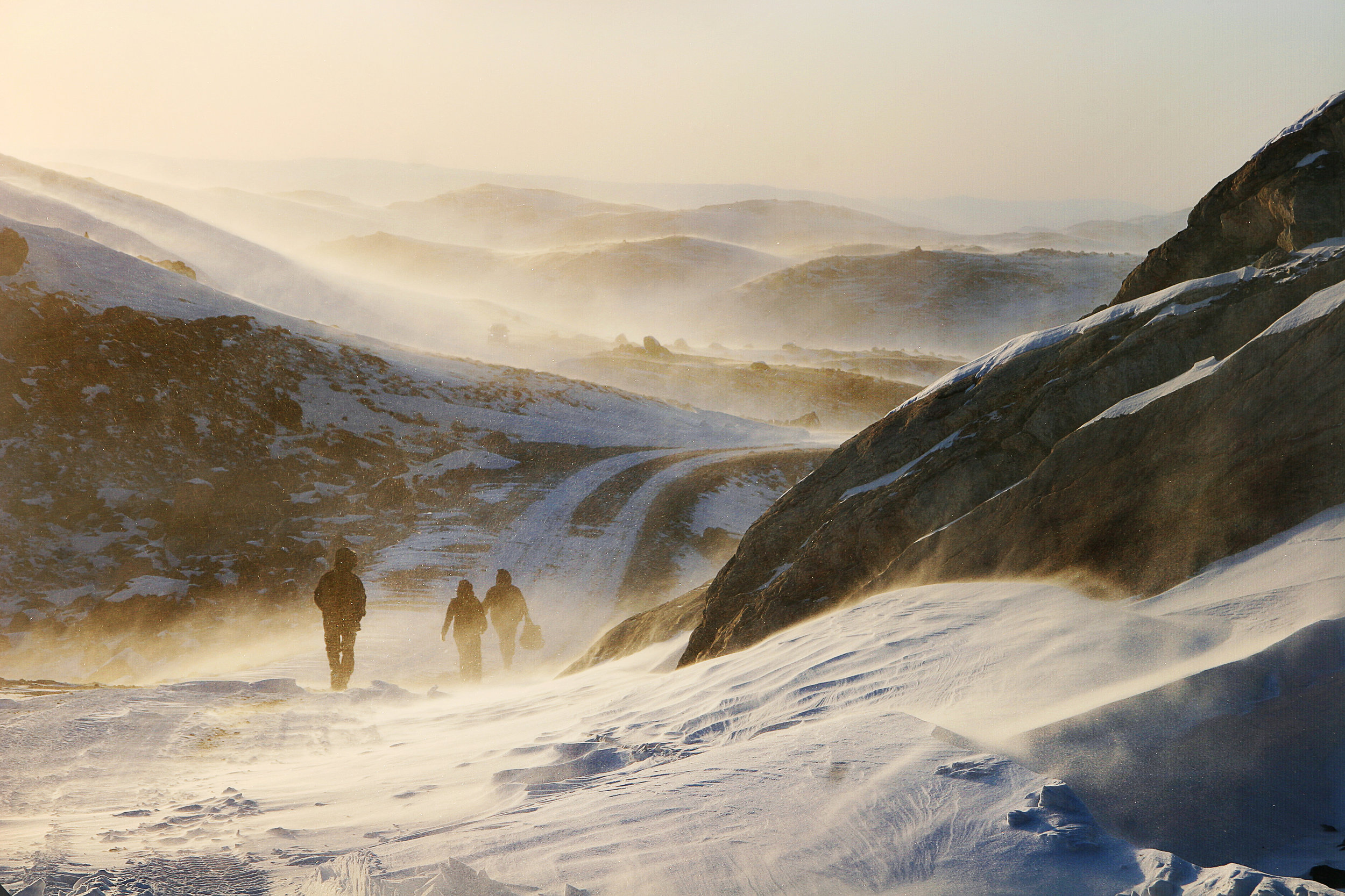 Winds pick up over the frozen tundra of the Russell Glacier near Kangerlussuaq, Greenland | November 4, 2009.