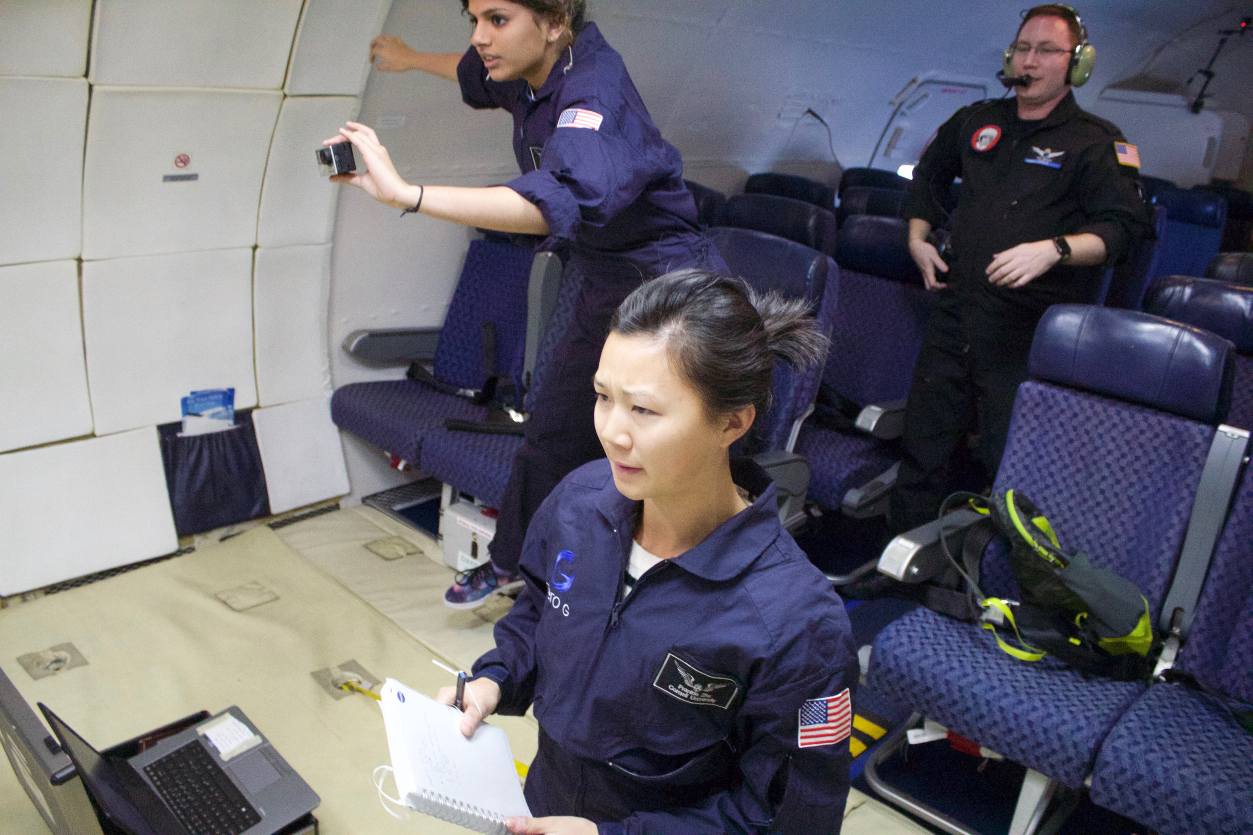 Observing and taking notes during microgravity experiment, as seen in  NASA press release