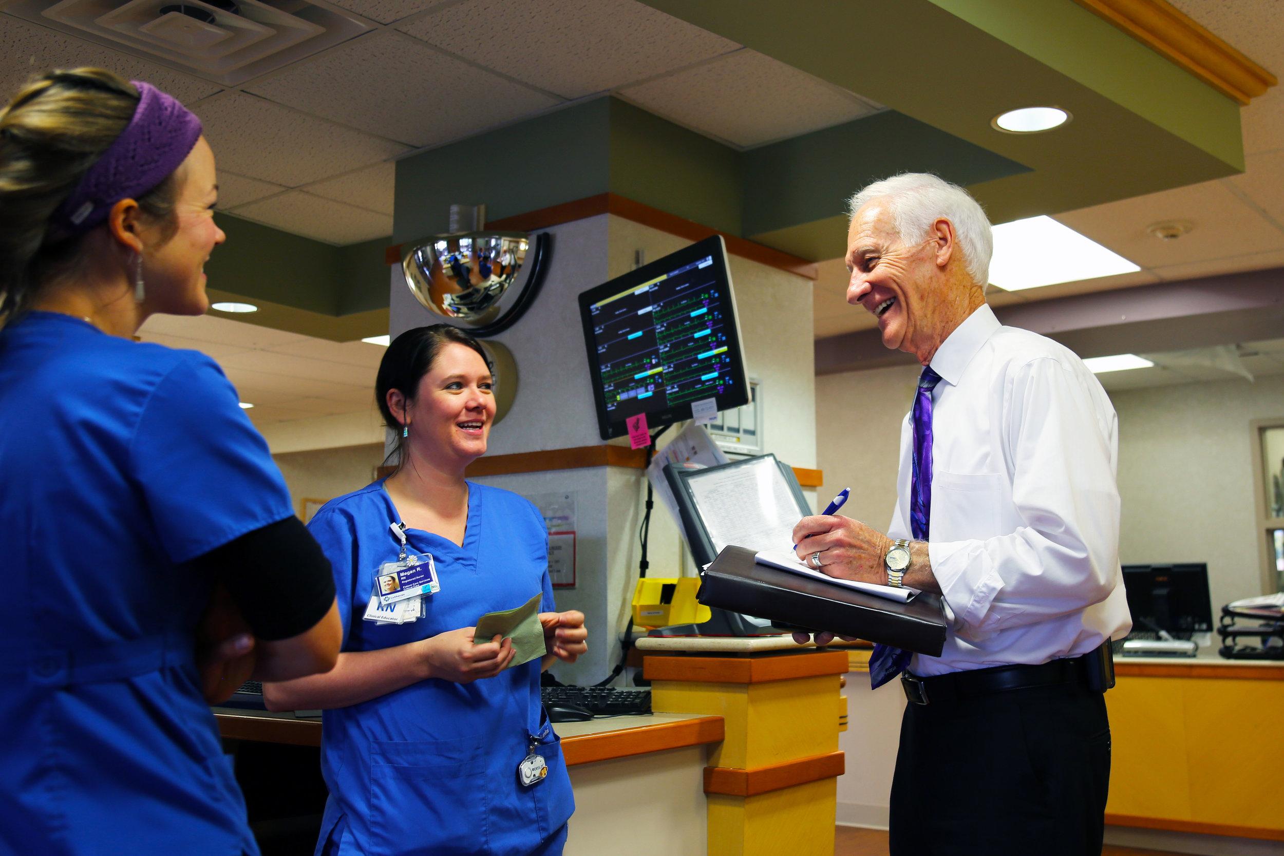 Spiritual care and nursing associates converse at Lutheran Medical Center