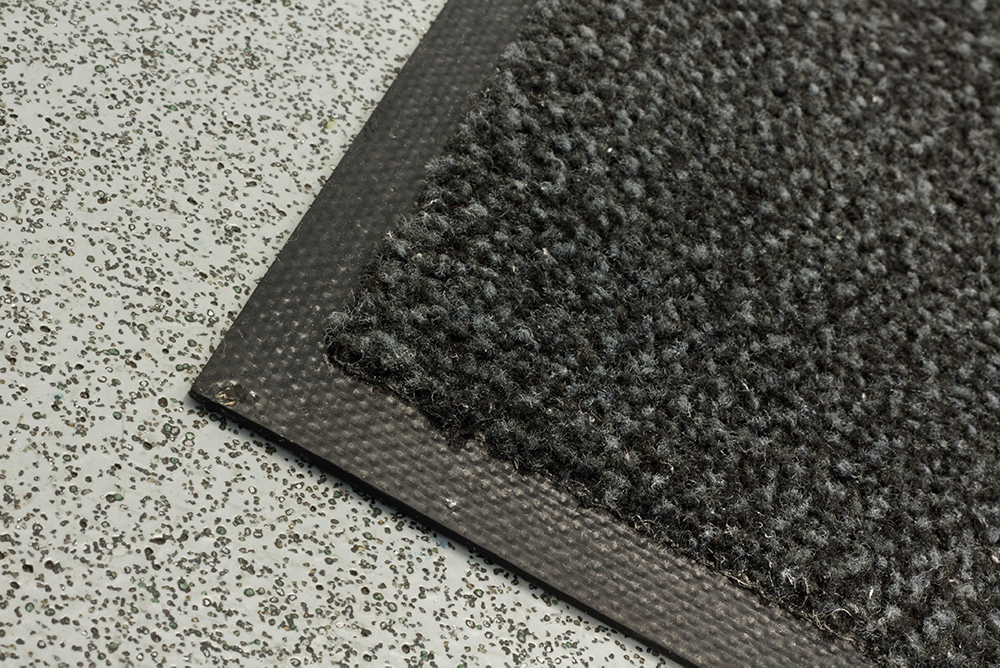 Dust - CONTROLMore than just laundry, we offer dust control mats which are often essential for health and safety at the work place.The entrance, an important part of any business. First impressions can often be the most important. Our dust control mats don't just prevent dust but also stops any other damaging substances entering the building, useful in keeping the entrance of your building clean and hygienic and keeping the air quality healthy.Placing a mat in the entrance is not hard and having it regularly clean can be overlooked quickly rendering the mat useless. Our rental service takes care of everything for you, we will pick up the mat and replace it whilst we clean the previous one. Simple and stress free. We will ensure you always have high dust and dirt areas covered, saving on expensive floor cleaning bills.+ GET A QUOTE