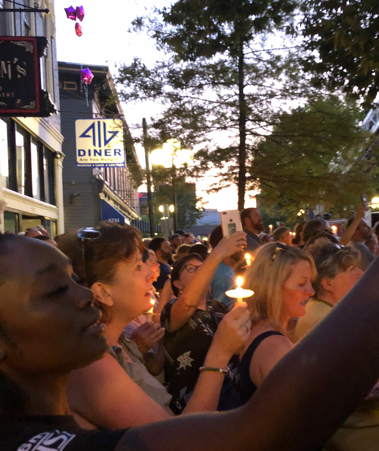 Dayton residents gathered together for a vigil in the Oregon District on August 4, 2019, the evening of the shooting.