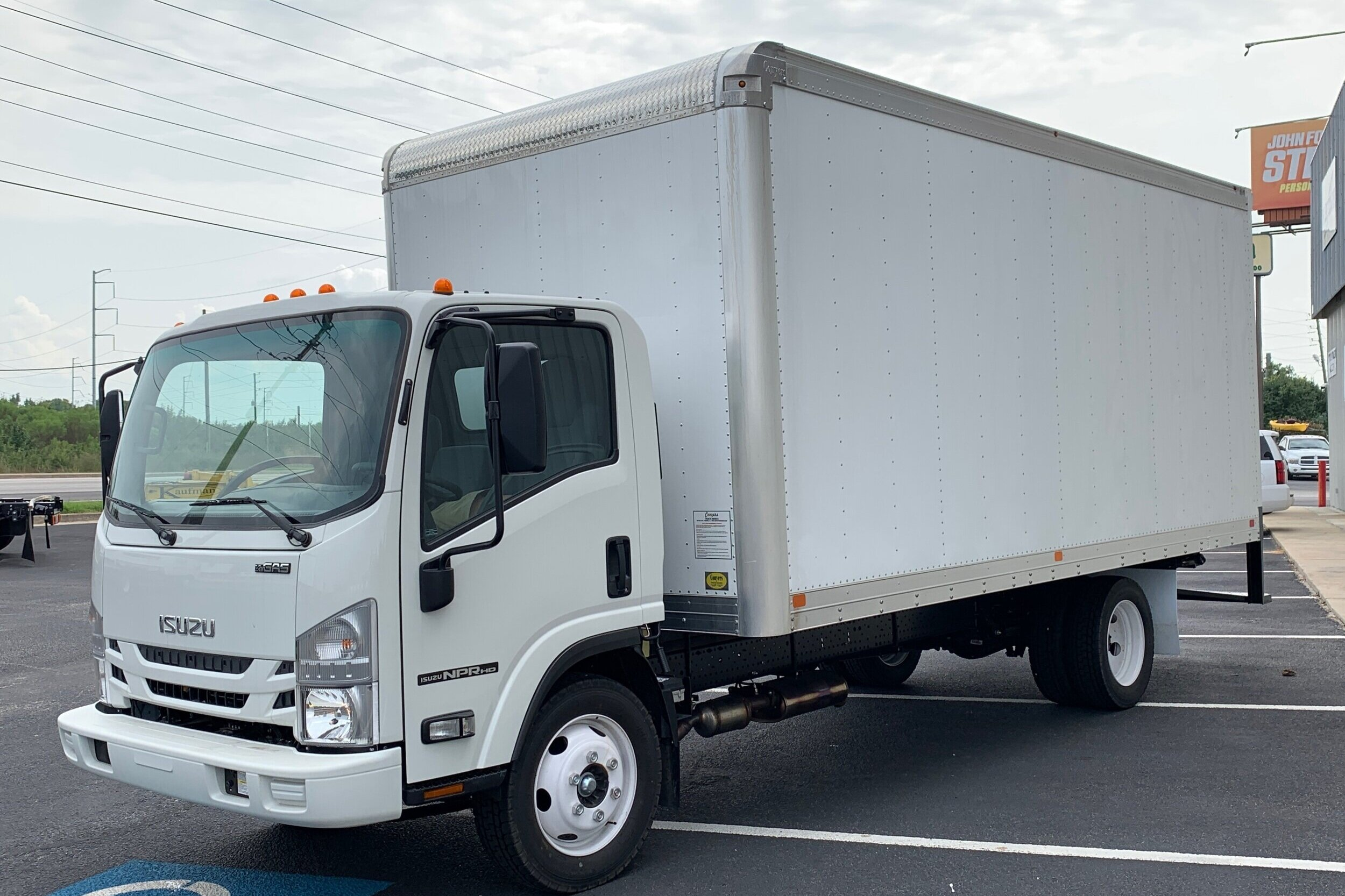 2019 Isuzu NPR Gas with 18' Box - Stock No: N2109Price: $47,560Financing Options:Class 4: 14,001 - 16,000 lbCategory: Box TruckCab Type: Cab OverEngine Make: IsuzuEngine Size: 6.0L GasFuel Type: GasolineVIN: 54DC4W1B3KS804428
