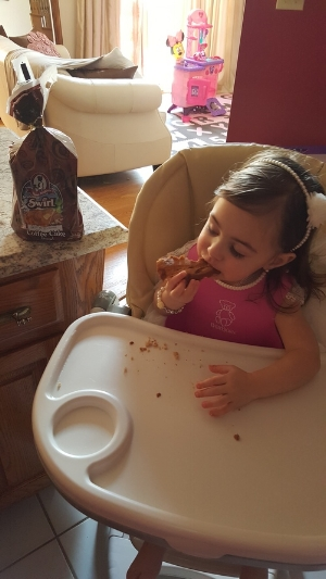My daughter thoroughly enjoying some Aunt Millie's Swirl Bread