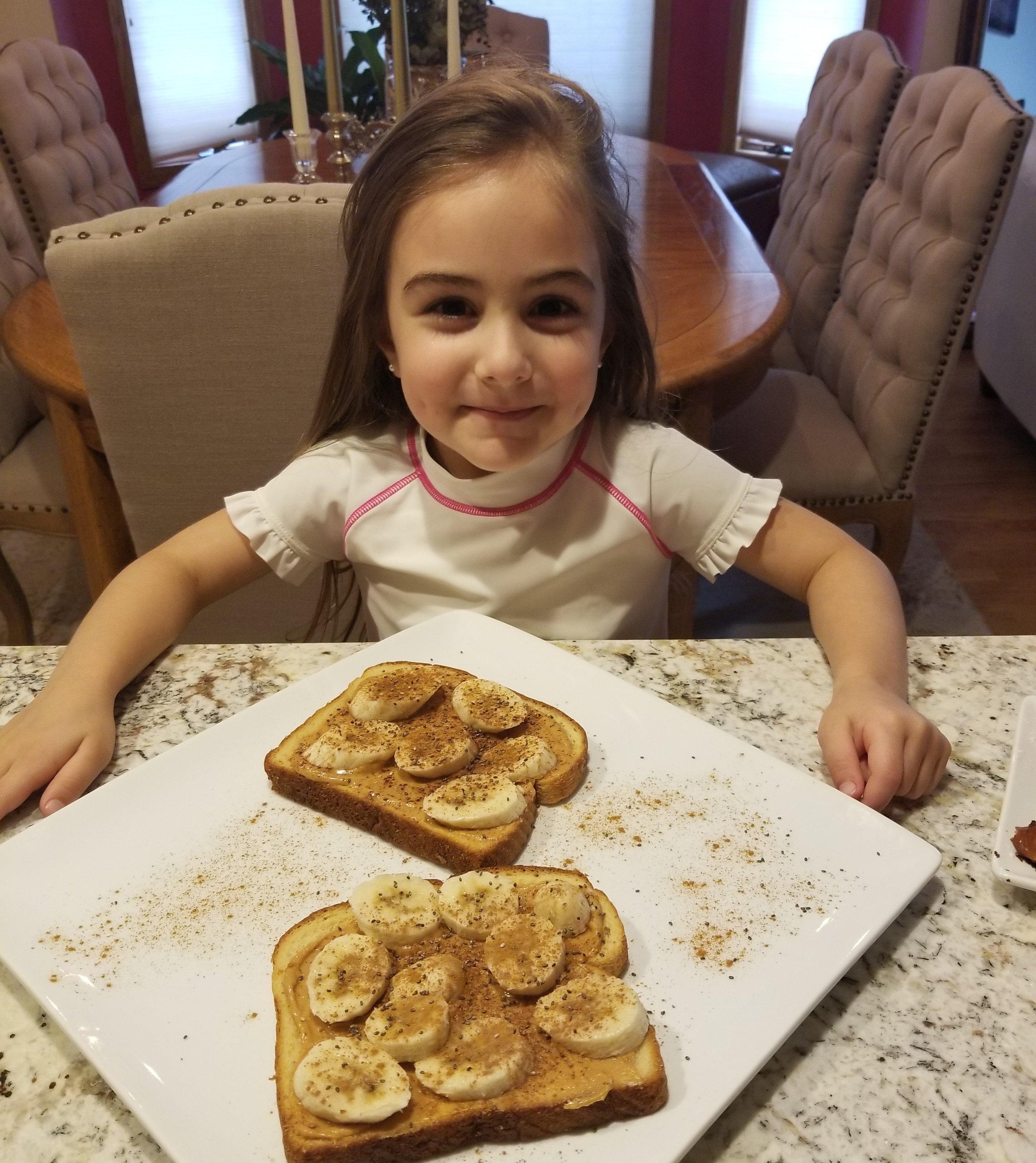 Anjolie enjoying her peanut butter and banana Hawaiian toast.