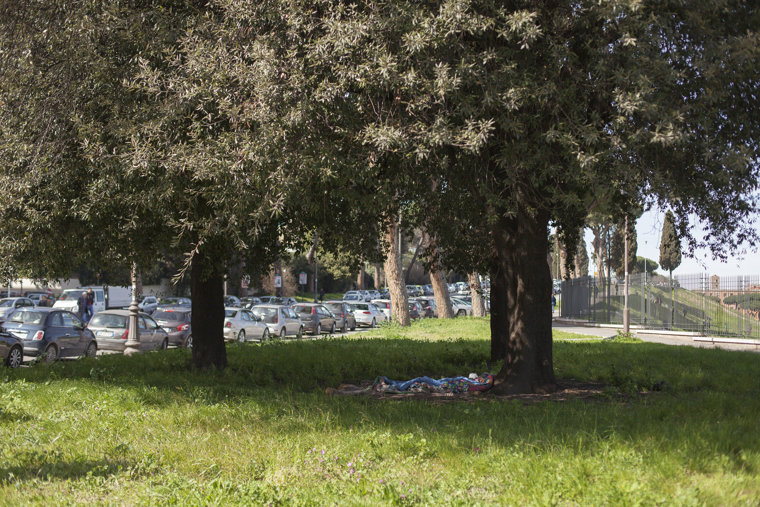 Makeshift bed under a tree, Rome, March 2017. From my project  Through The Eye of a Needle