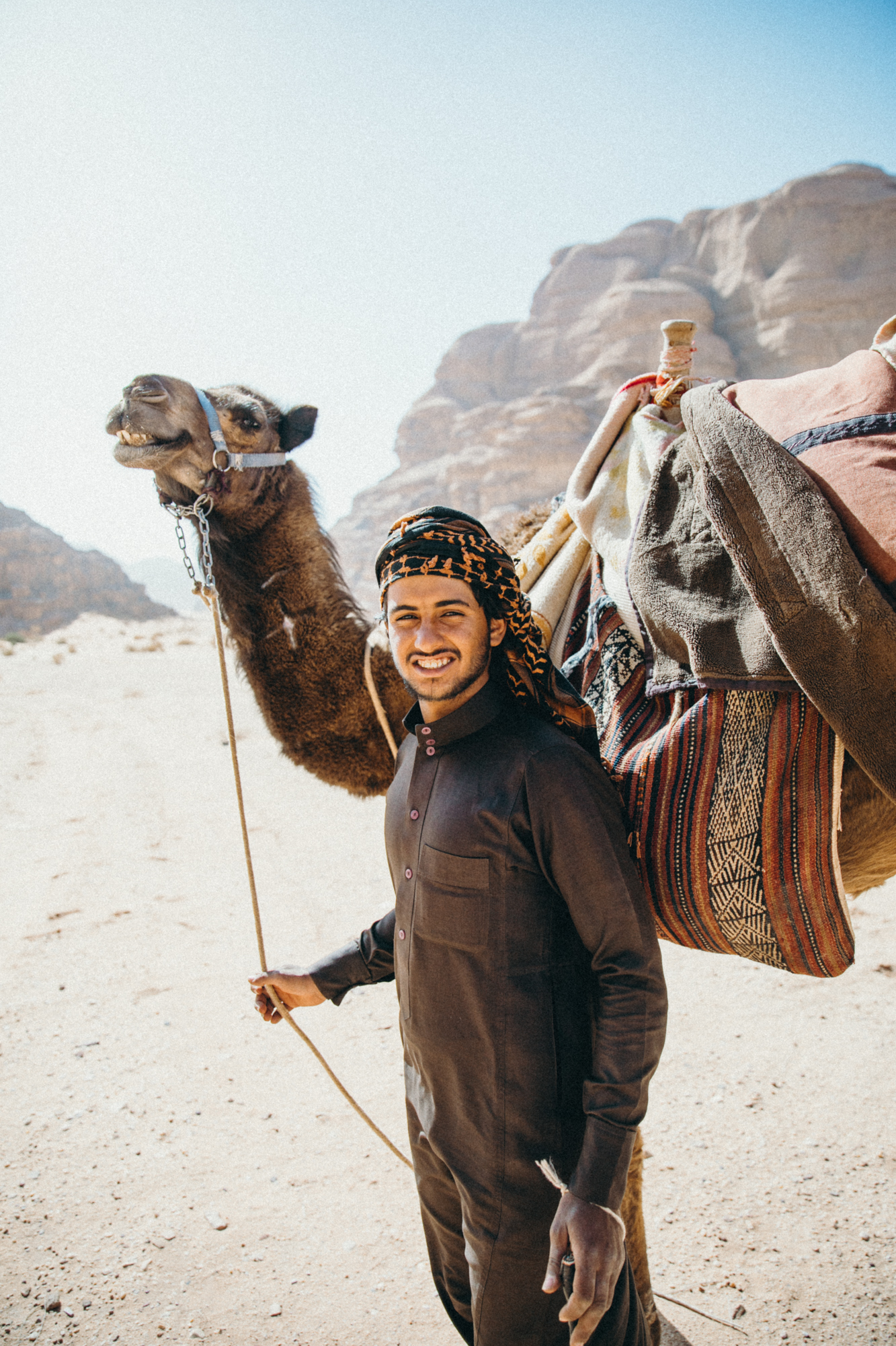 Friendly guy leading his camels – look at that camel's smile.. hahah.