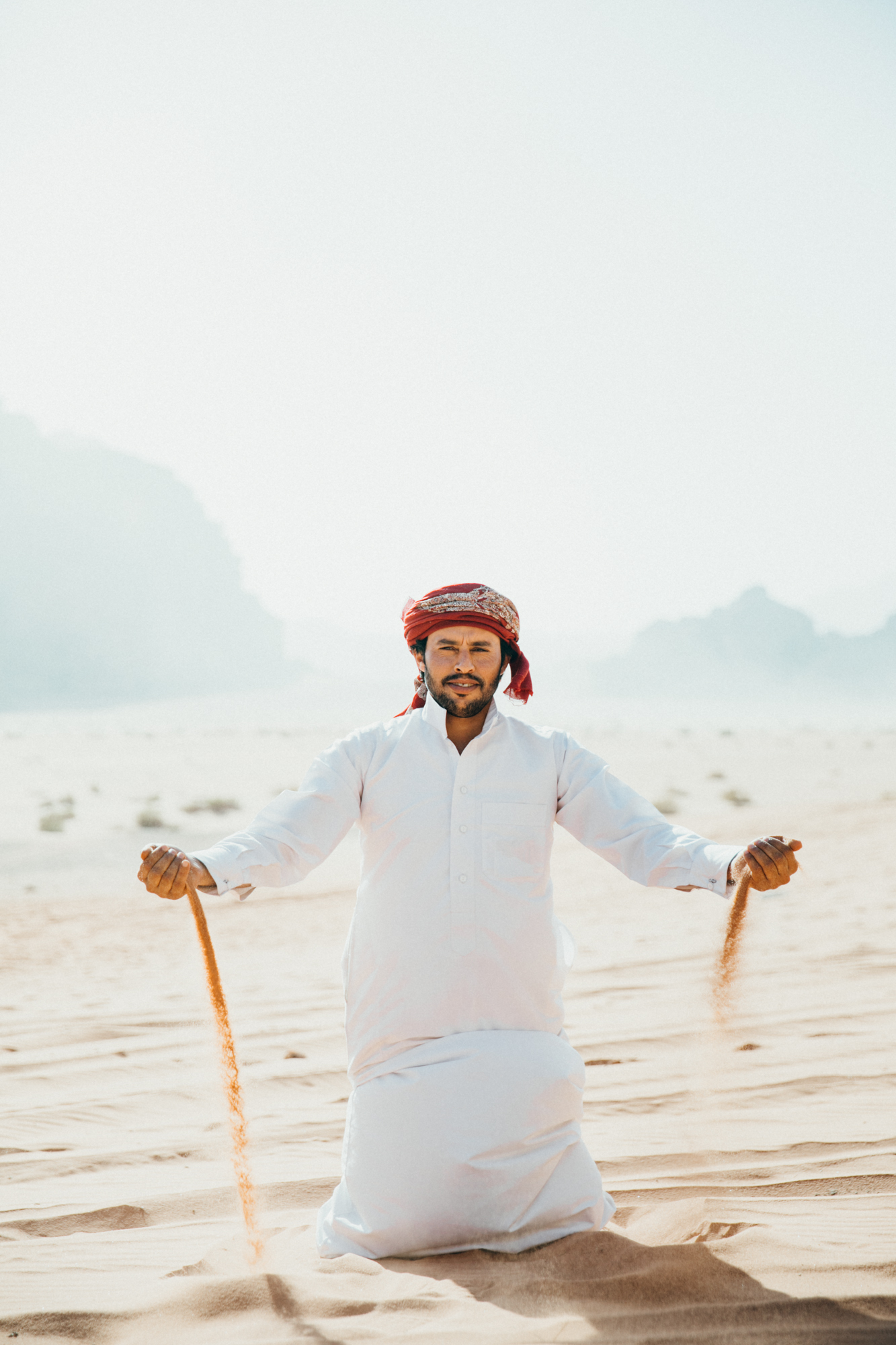We were taking photos of each other dropping sand and then our guide came in and wanted to be part of the action! His photo turned out the best, of course.