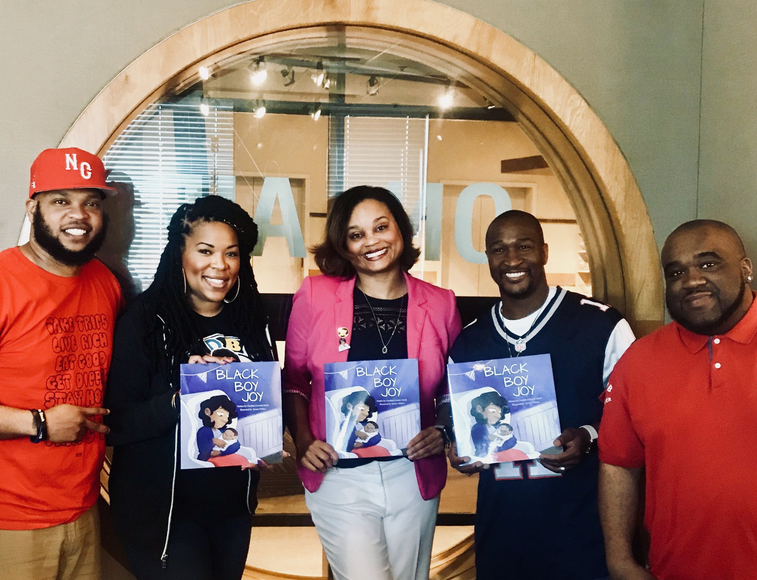 CMO Charlitta Hatch (@raisingblackboyjoy, center) featured on Working Woman Wednesday segment at WPEG Power 98 FM in Charlotte. Pictured here with the hosts of No Limit Larry & the Morning Madd House (from left): Comedian Burpie (@iamburpie), Ms. Jessica the Girl Next Door (@heymsjessica), No Limit Larry (@noleezy) and Mr. Incognito (@incognito98) -  May 2018