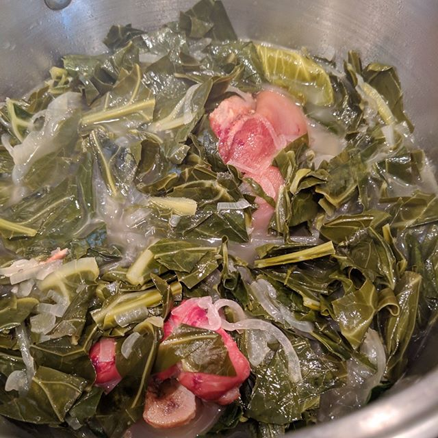 Working on my collard greens game. Smoked ham hocks, onions, garlic, bourbon, vinegar, spices and them greeeeens . . . . #collardgreens #greens #soulfood #hamhock #smokedmeats #cheflife #southernfood #sundayfunday