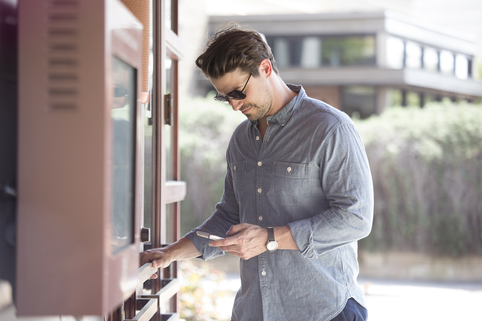 Telcom_Male with Phone by Store.jpg