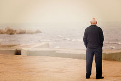 stock-photo-a-man-looking-at-the-sea-on-the-dock-image-has-a-vintage-effect-287967365.jpg