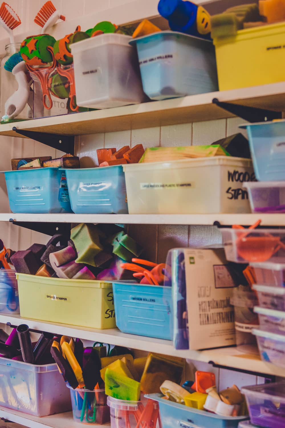 A well stocked resource cupboard with overflowing buckets at chiselhurst