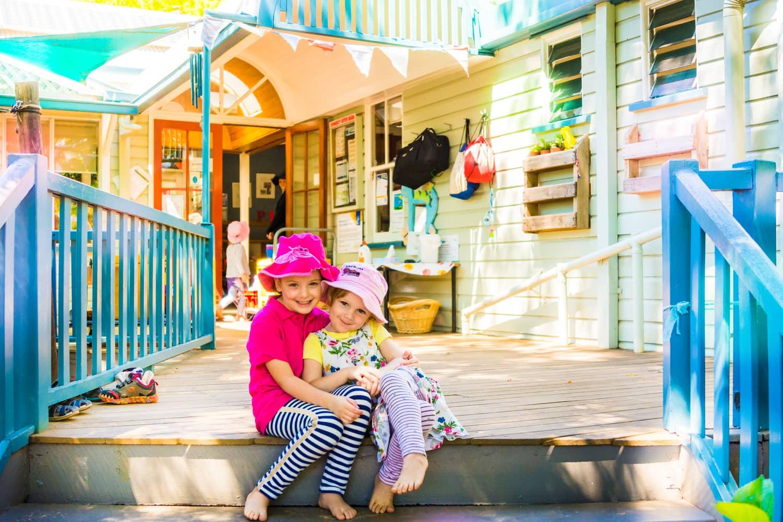 Chiselhurst friends sitting on steps near the kindergarten entrance