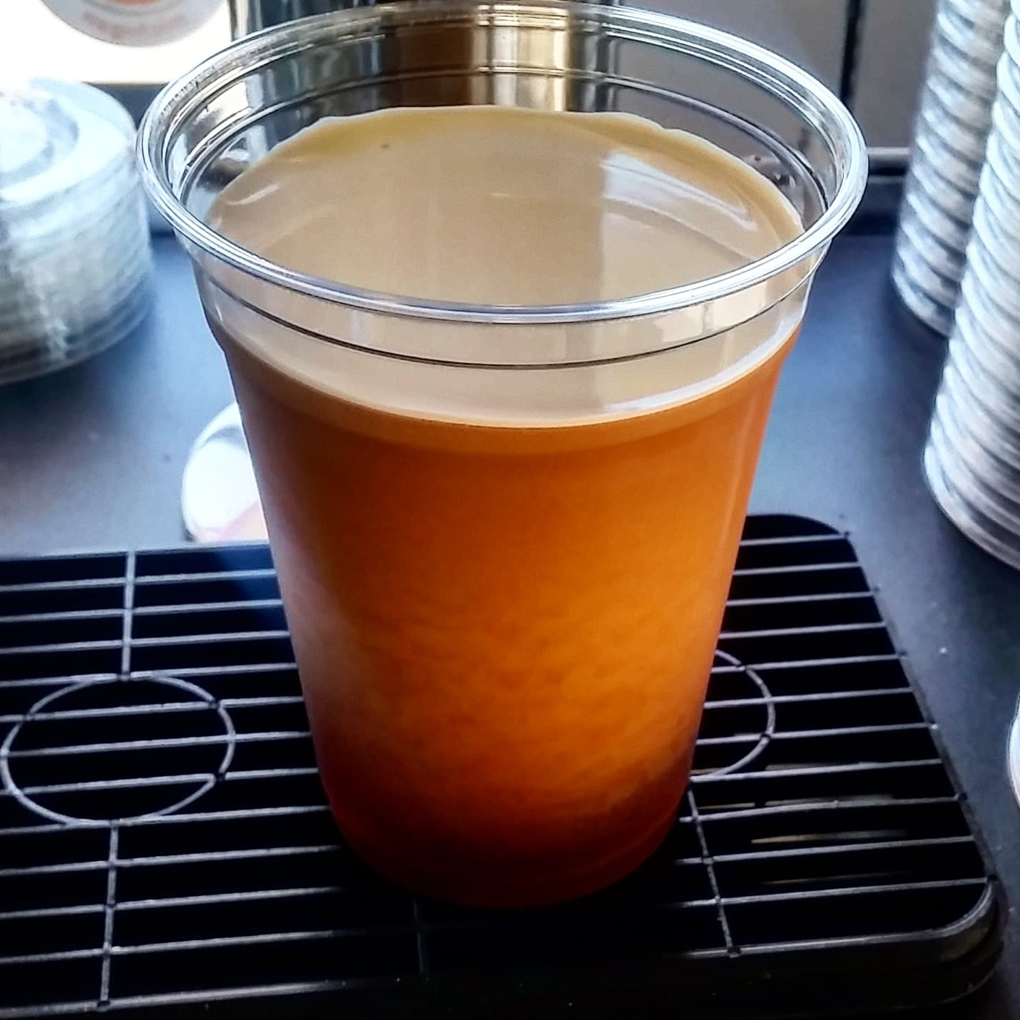 Nitro Cold Brew Coffee cascades out of the faucet with a smooth finish