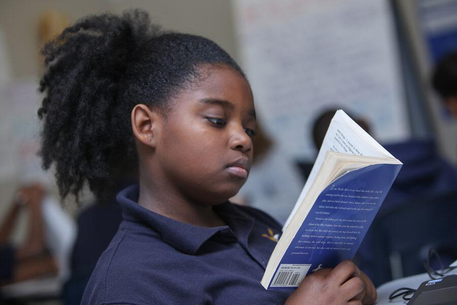 purpose-prep-academy-scholar-reading-book.jpg