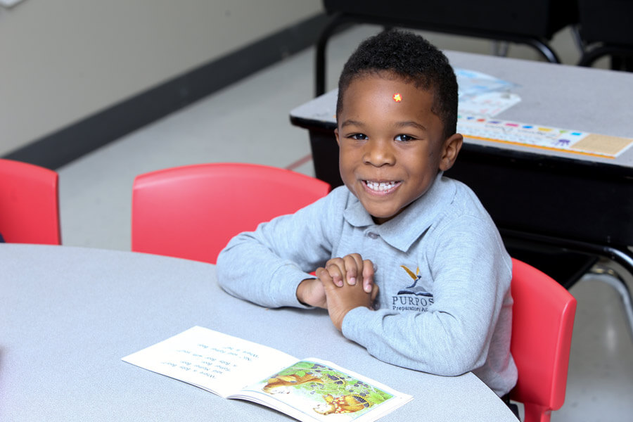 A Happy Student sitting in reading class.