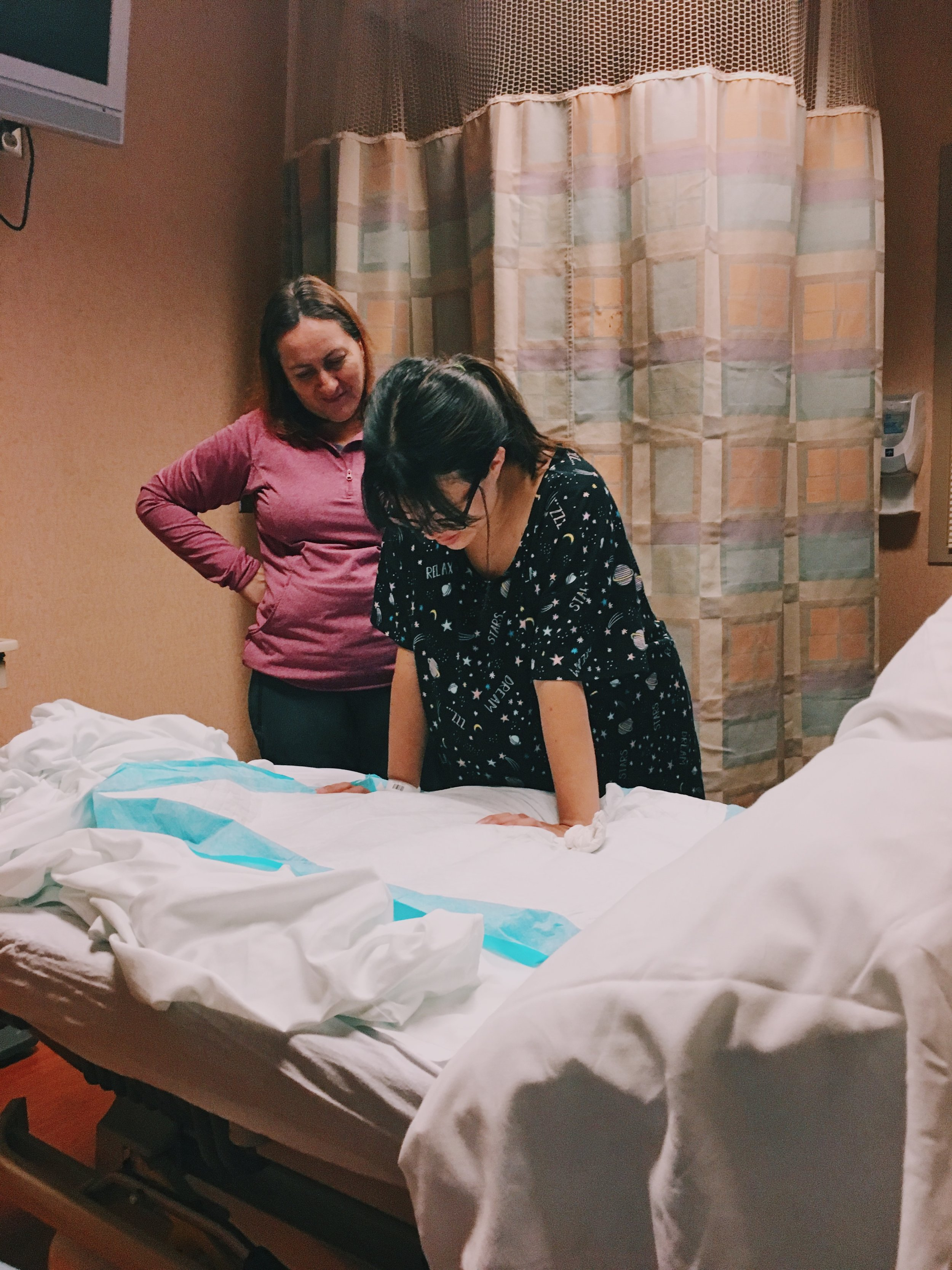 In the triage room, while we waited to be admitted to the birthing center unit.