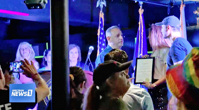 Blaze Bernstein's parents, Jeanne Pepper and Gideon Bernstein, take part in the 2019  Blaze It Forward  OC Pride LGBT Parade, dedicated to their son in Santa Ana on Saturday, June 22, 2019. Shown here with Congressman Gil Cisneros. (Photo by Spectrum 1 News)