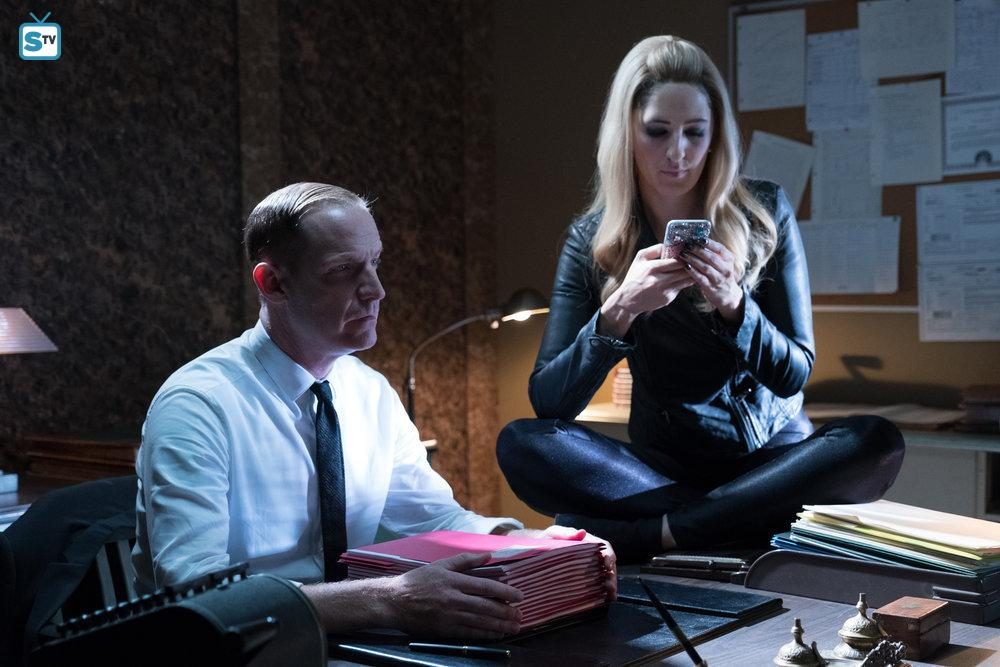 Shawn (Marc Evan Jackson) and Janet (D'Arcy Carden) sit in judgement of Michael