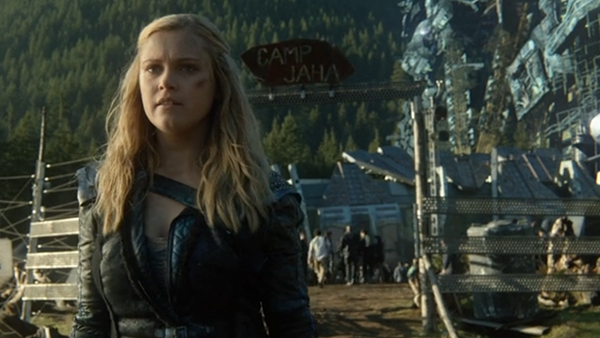 Clarke walks away from the gates of Camp Jaha