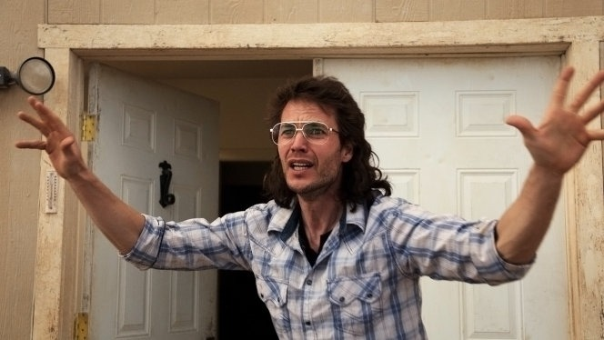 David Koresh (Taylor Kitsch) trying to stop the raid on the compound.